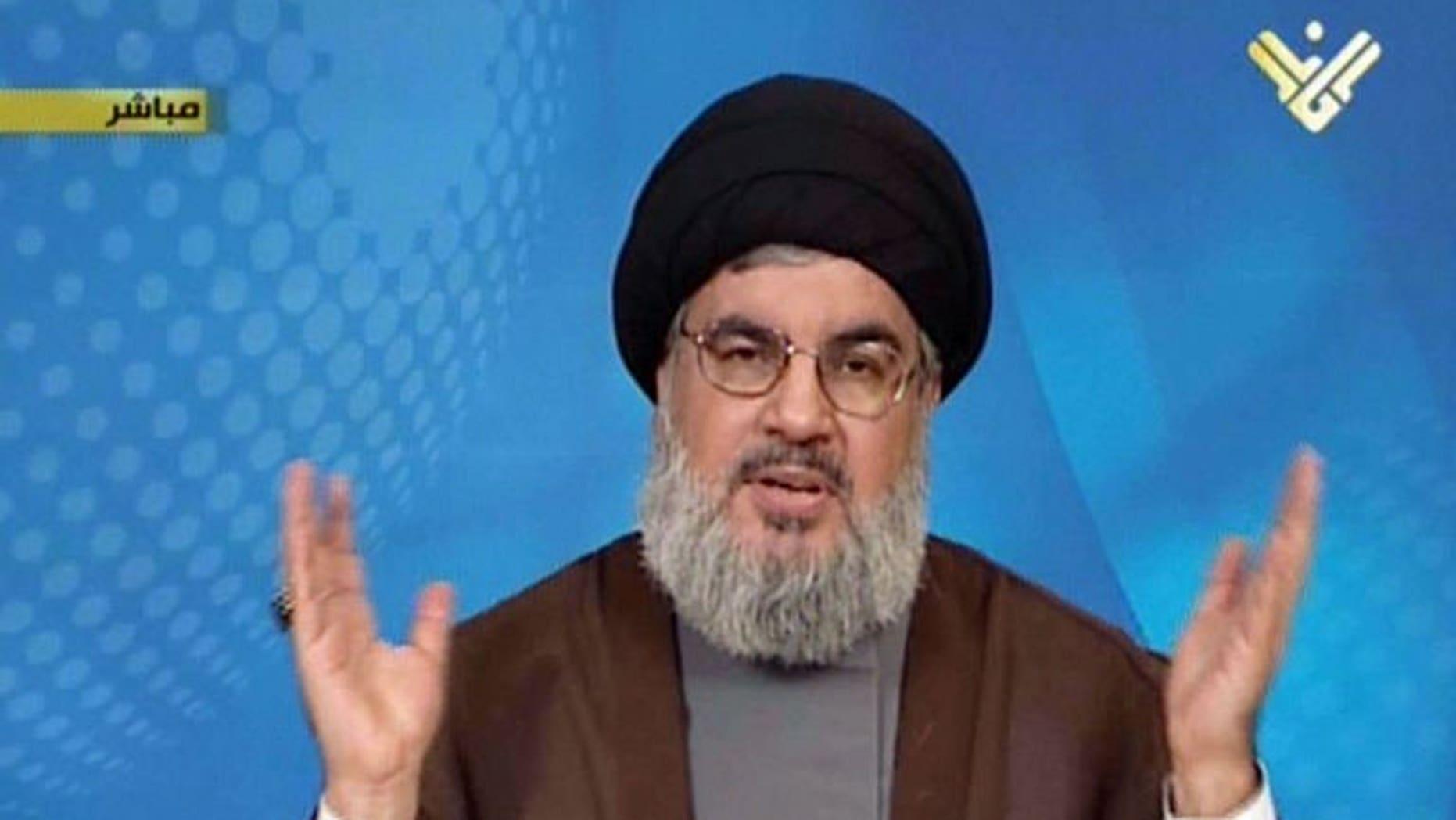 An image grab from Hezbollah's al-Manar TV shows Hassan Nasrallah, head of Hezbollah, on September 23, 2013 in Lebanon.