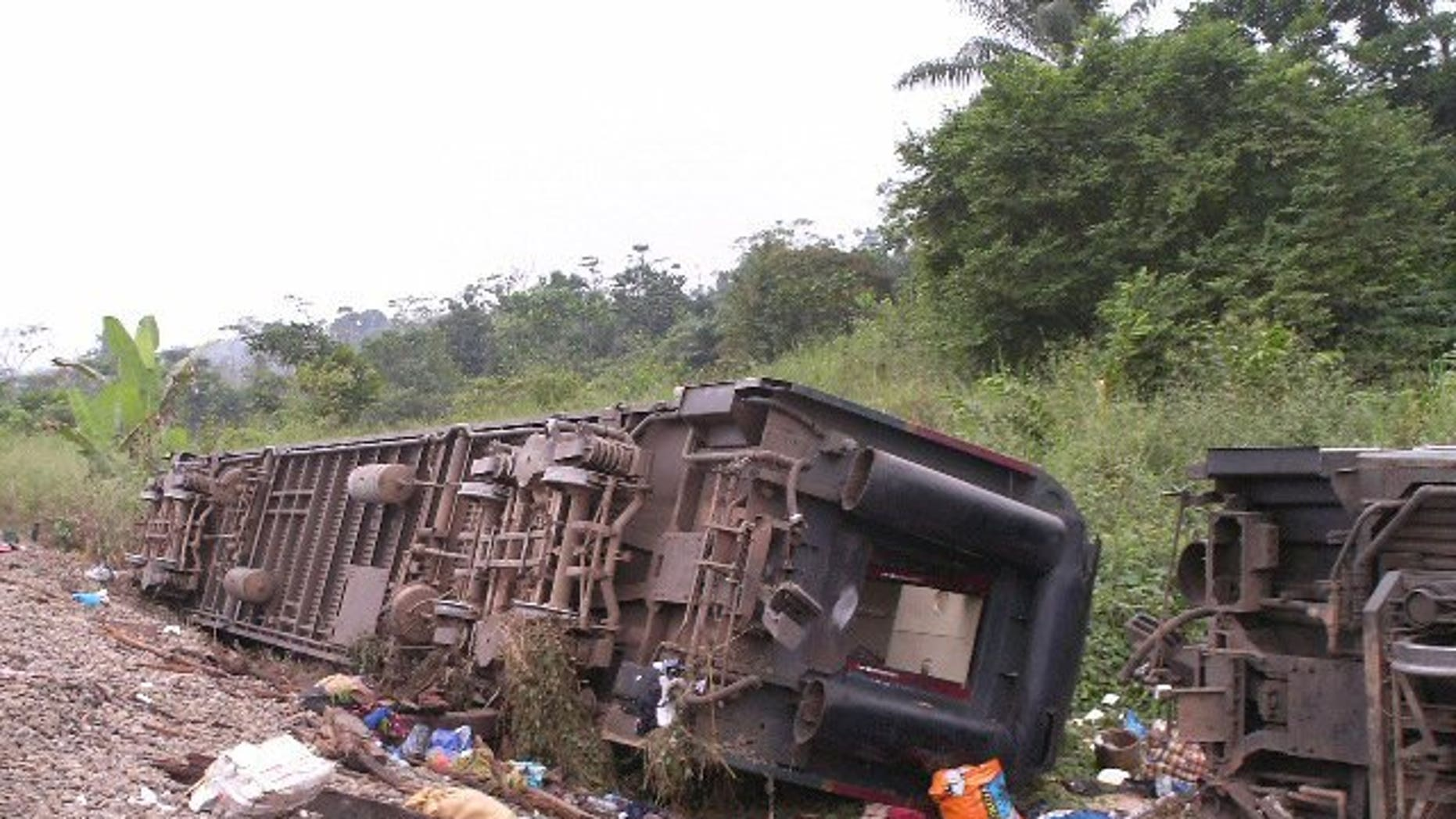 An overturned carriages lie near the rail track in Yanga, Congo-Brazzaville, on June 22,2010. A rail crash killed three people and injured 28 others in the Republic of Congo, when a passenger train hit one laden with oil tankers, a transport official said Tuesday.