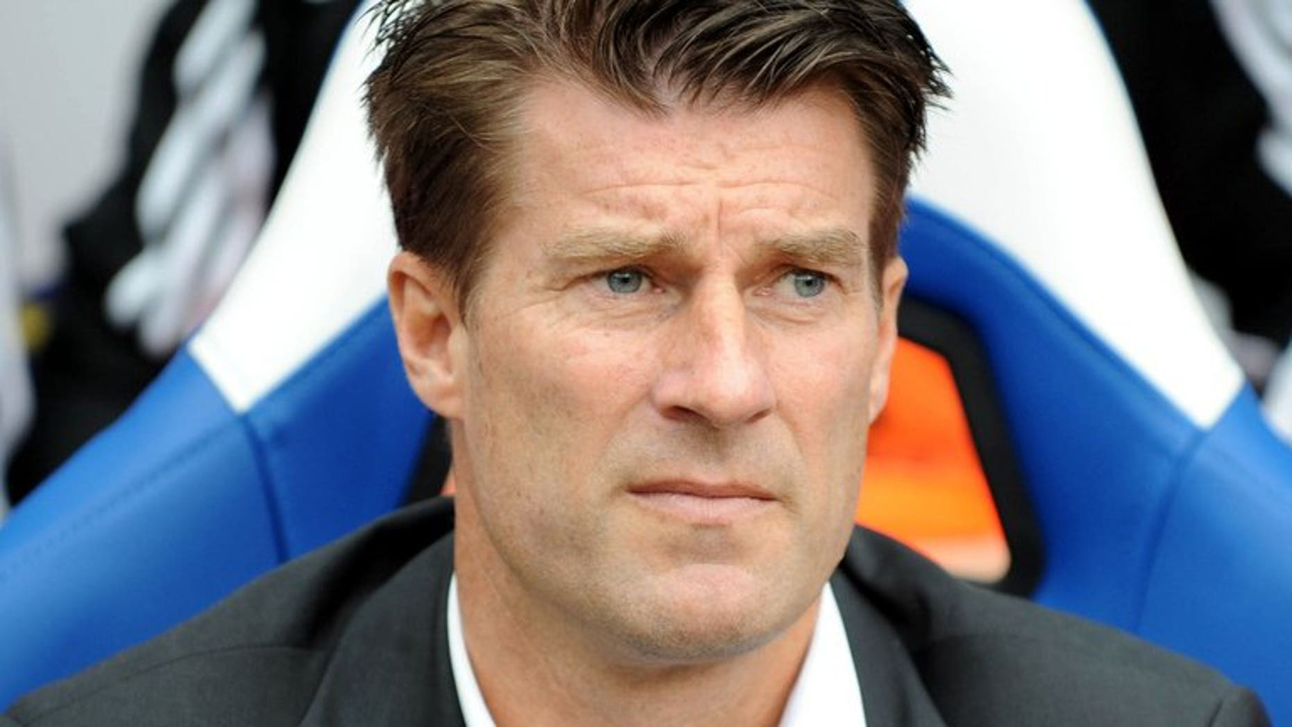 Swansea City's Danish manager Michael Laudrup watches during the English Premier League football match between Crystal Palace and Swansea City at Selhurst Park in south London on September 22, 2013.