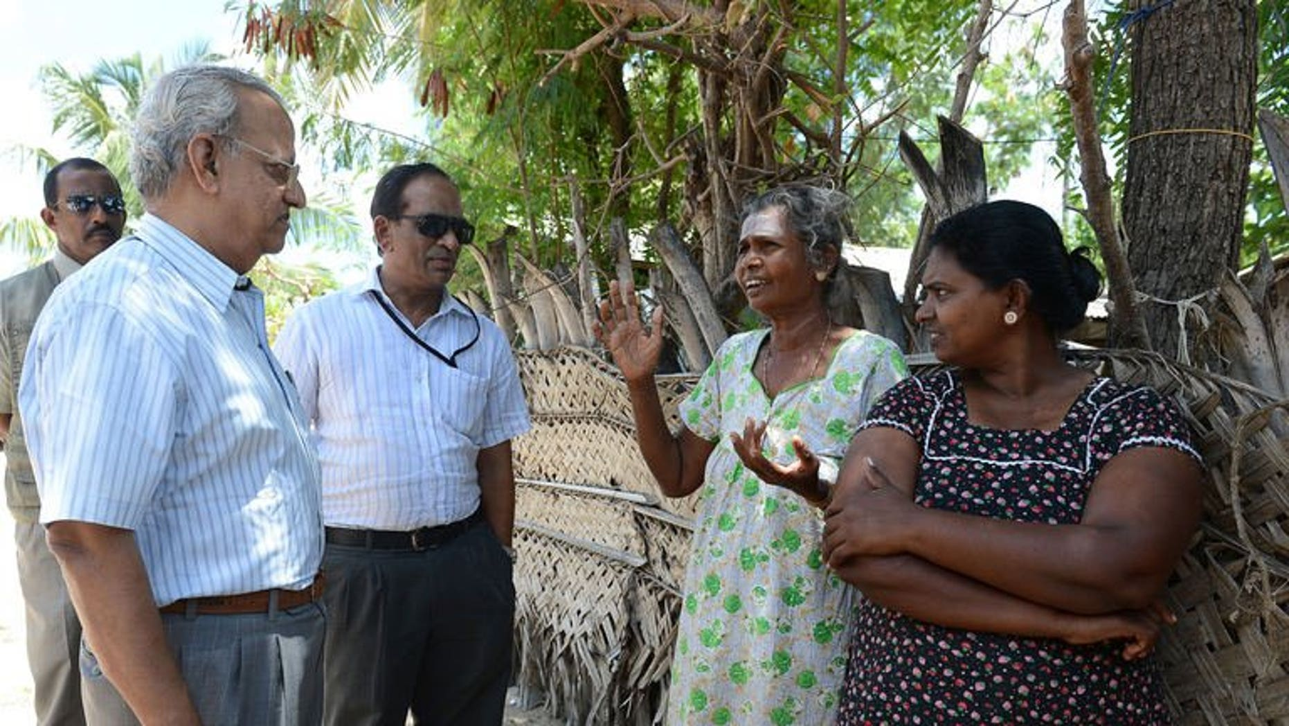 Foreign observers speak with Sri Lankan Tamil residents at The Kanniamman Welfare Centre at the country's northern most tip of Point Pedro on September 19, 2013.