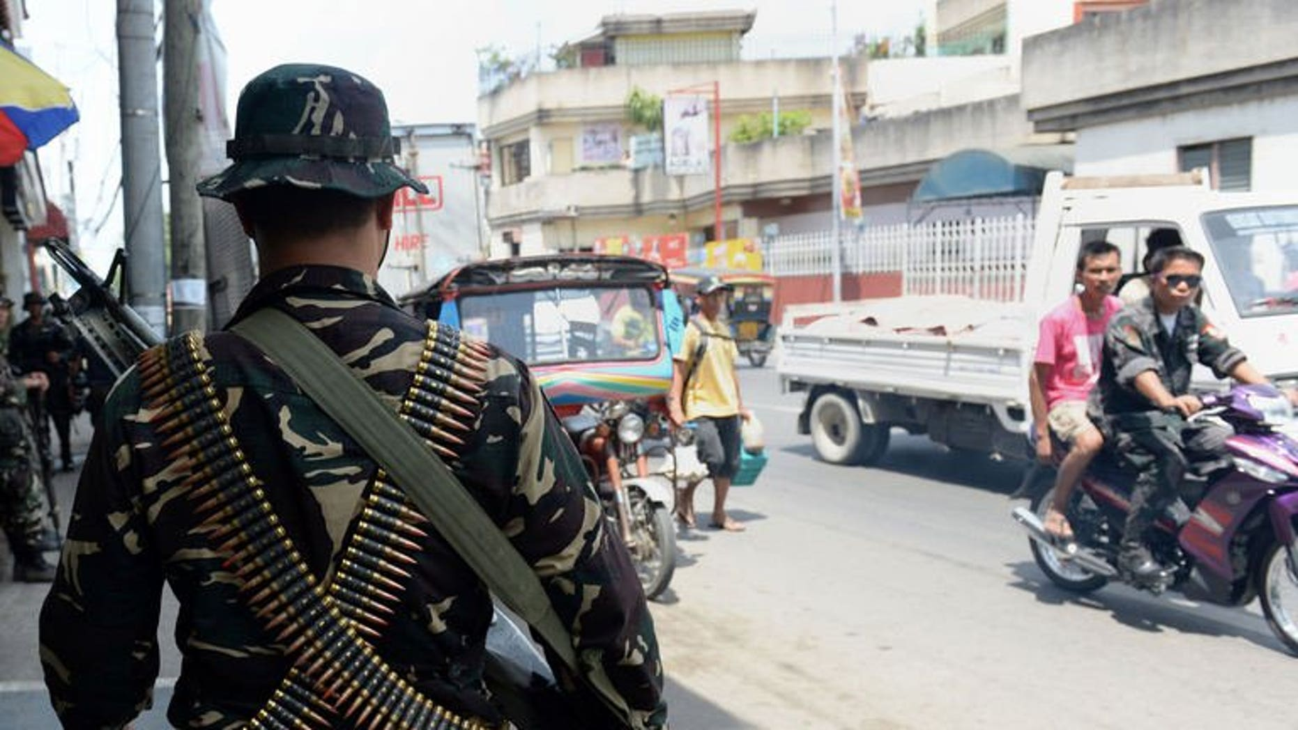 Philippine soldiers patrol the streets as government forces clash anew with remnants of Muslim rebels in Zamboanga City, on southern island of Mindanao on September 21, 2013.