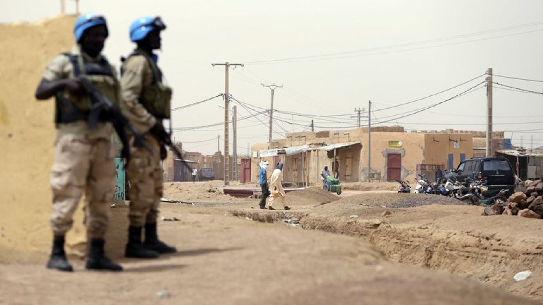 United Nations soldiers patrol on July 27, 2013 in the northern Malian city of Kidal.