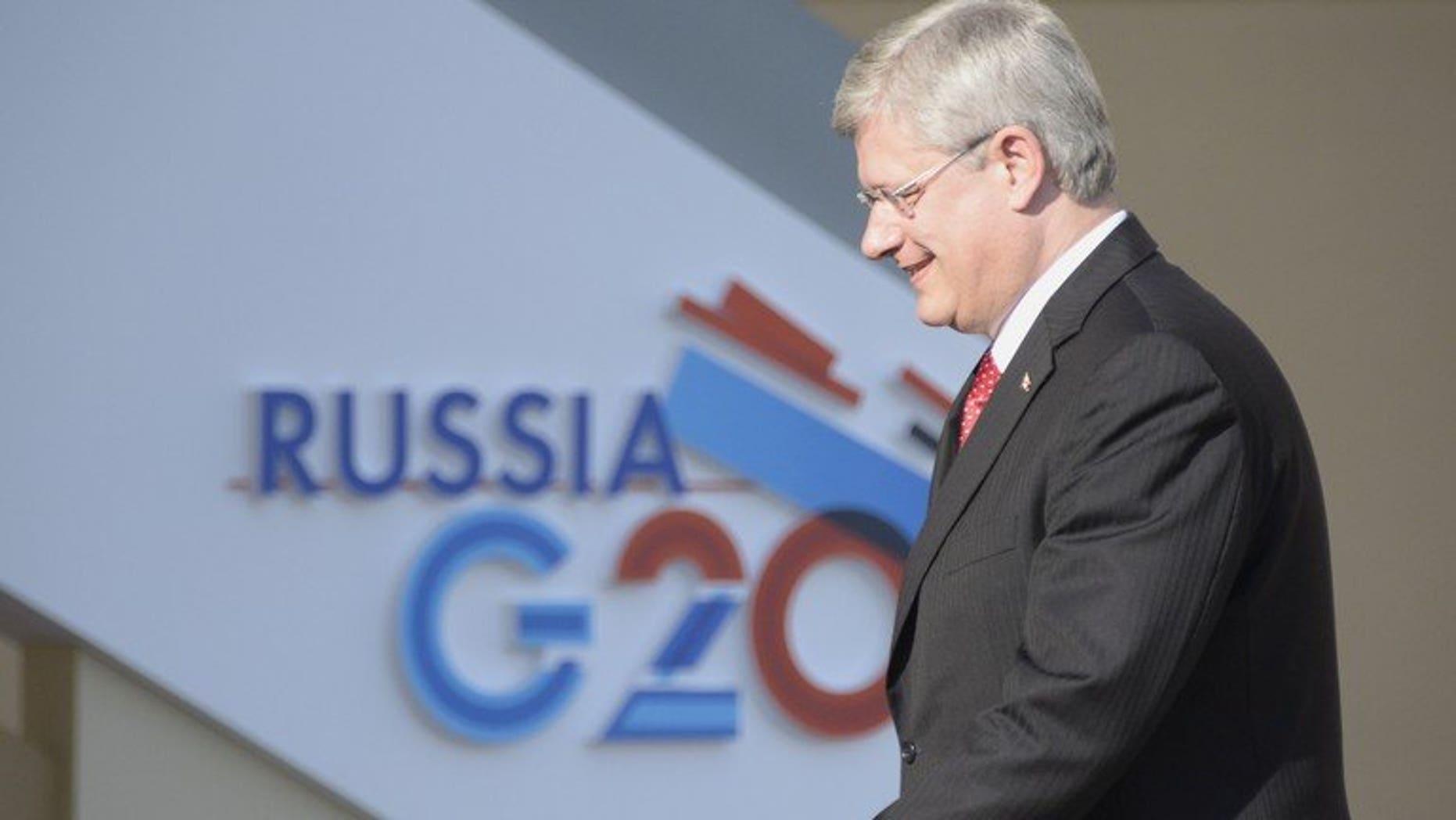 Canada???s Prime Minister Stephen Harper arrives for the start of the G20 summit on September 5, 2013 in Saint Petersburg.