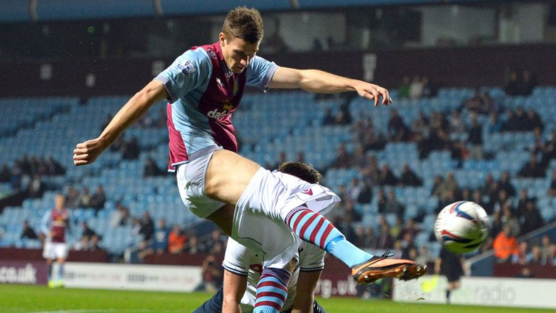 Aston Villa's Danish forward Nicklas Helenius loses his shorts during a challenge from Tottenham Hotspur's Belgian defender Jan Vertonghen at the League Cup football match between Aston Villa and Tottenham Hotspur at Villa Park in Birmingham, West Midlands, on September 24, 2013.