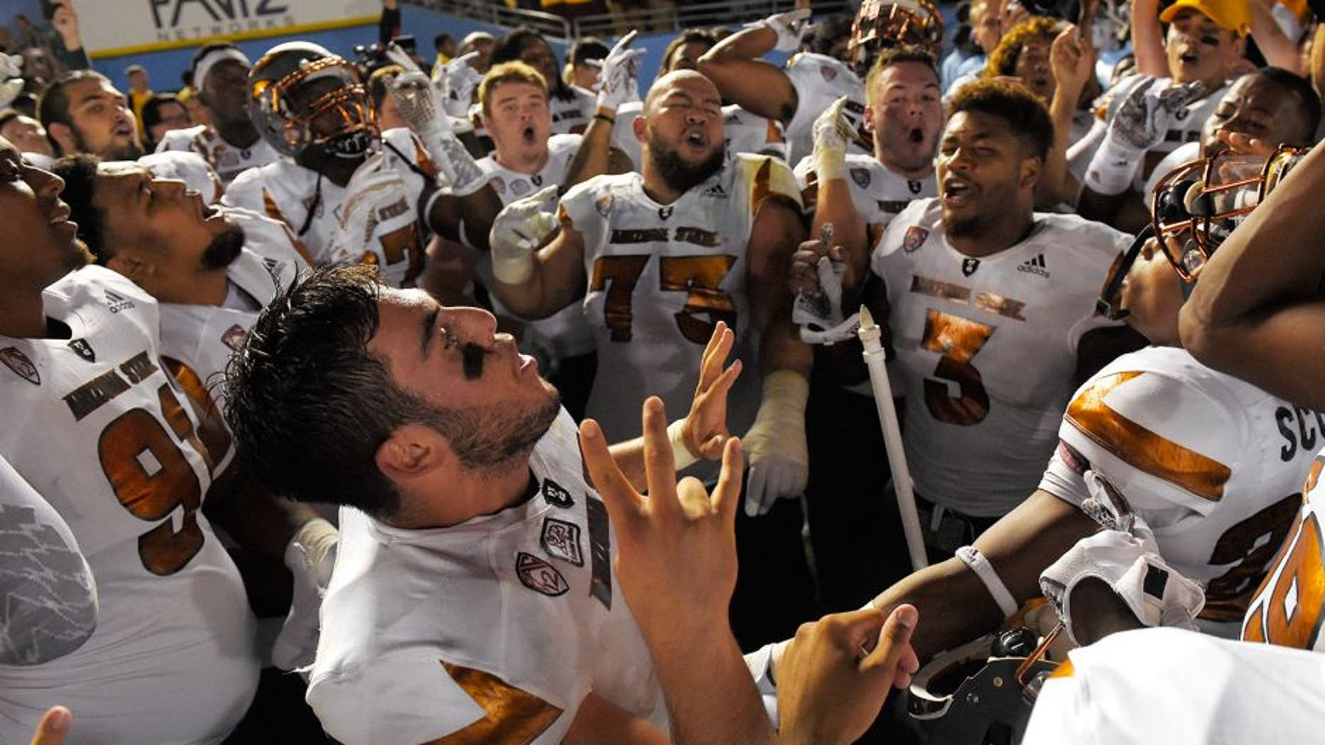 Arizona State quarterback Mike Bercovici, below, celebrates with teammate after they defeated UCLA in an NCAA college football game, Saturday, Oct. 3, 2015, in Pasadena, Calif. Arizona State won 38-23. (AP Photo/Mark J. Terrill)