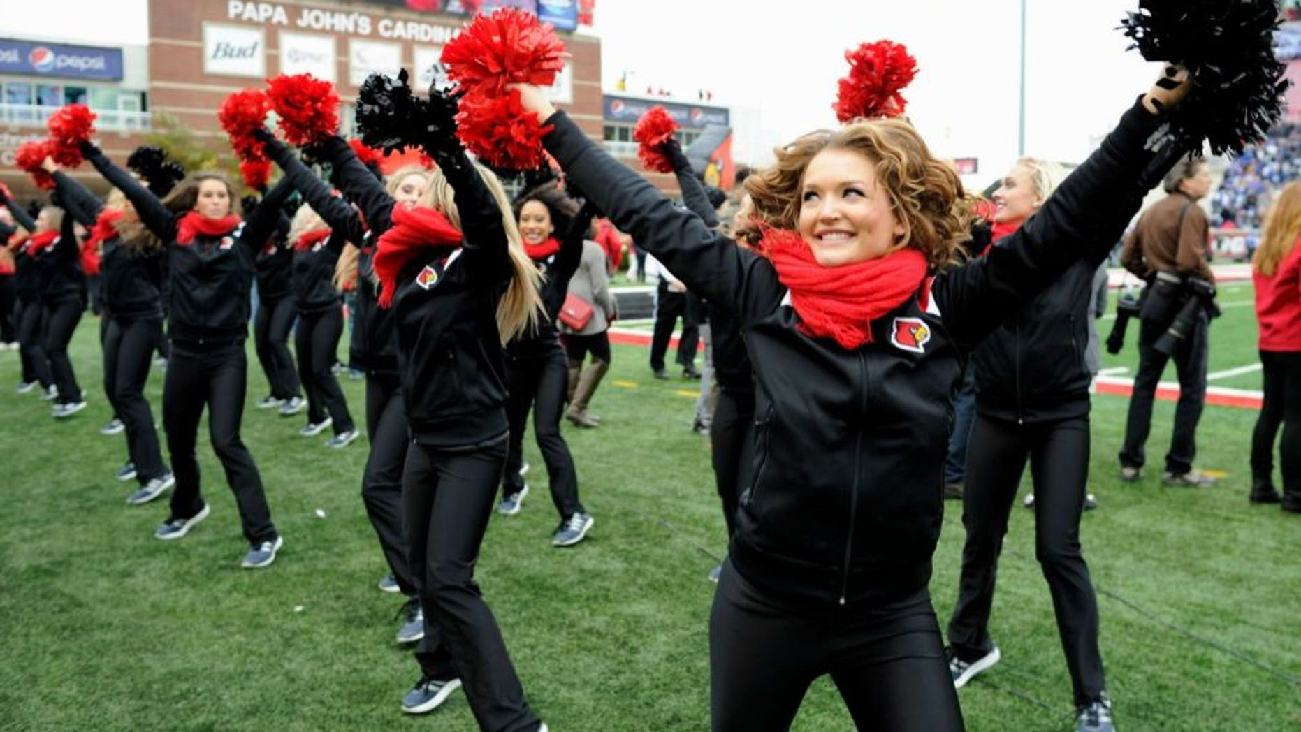 Nov 29, 2014; Louisville, KY, USA; The Louisville Cardinals cheerleaders perform during the second quarter against the Kentucky Wildcats at Papa John's Cardinal Stadium. Mandatory Credit: Jamie Rhodes-USA TODAY Sports