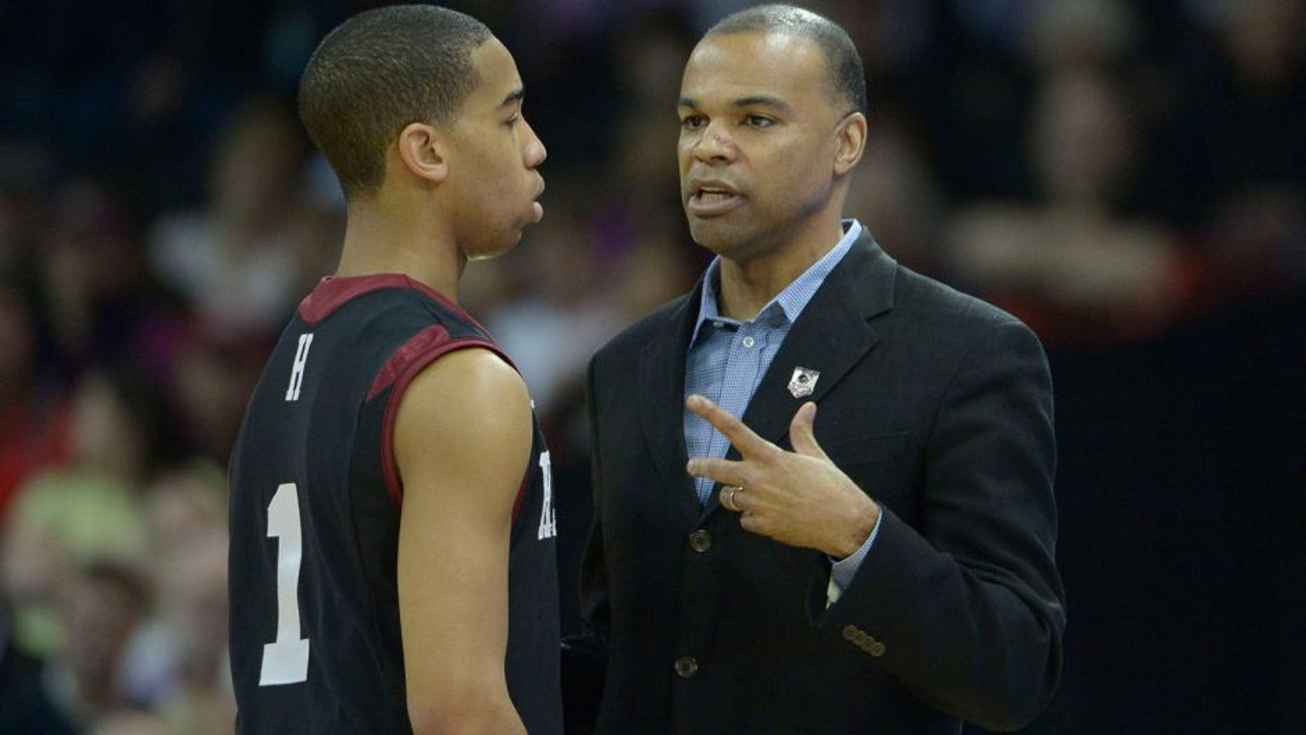 Mar 20, 2014; Spokane, WA, USA; Harvard Crimson head coach Tommy Amaker (right) instructs guard Siyani Chambers (1) against the Cincinnati Bearcats in the first half of a men's college basketball game during the second round of the 2014 NCAA Tournament at Veterans Memorial Arena. Mandatory Credit: Kirby Lee-USA TODAY Sports