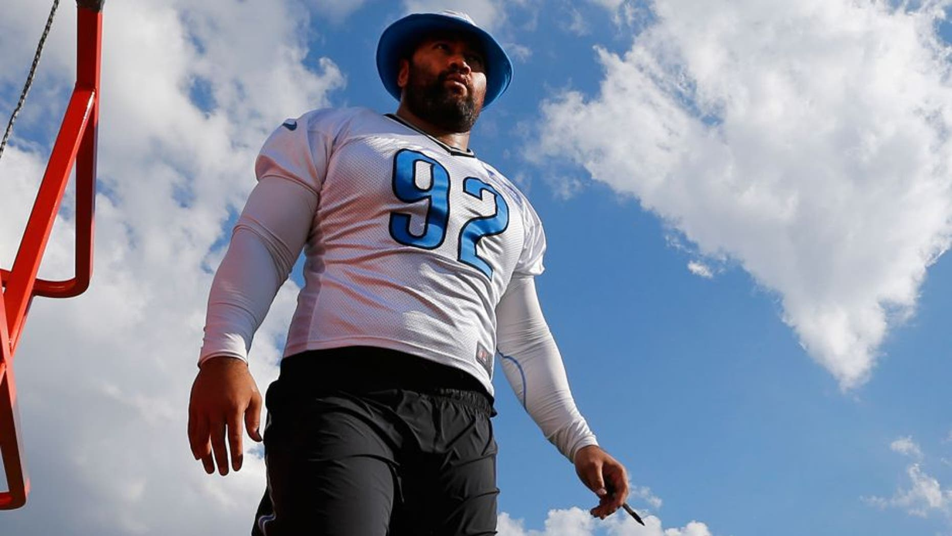Detroit Lions defensive tackle Haloti Ngata walks on the practice field during NFL football training camp in Allen Park, Mich., Monday, Aug. 3, 2015. (AP Photo/Paul Sancya)