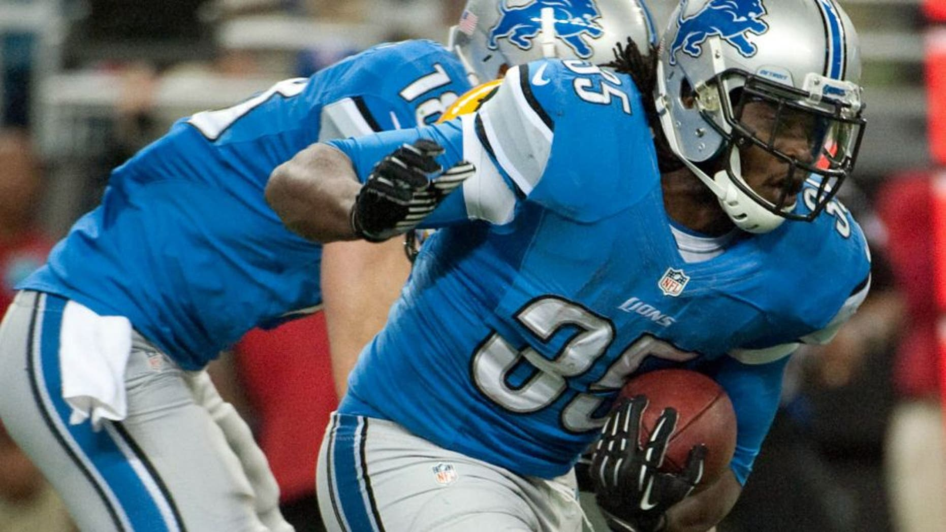 Nov 28, 2013; Detroit, MI, USA; Detroit Lions running back Joique Bell (35) runs the ball during the first quarter against the Green Bay Packers during a NFL football game on Thanksgiving at Ford Field. Mandatory Credit: Tim Fuller-USA TODAY Sports
