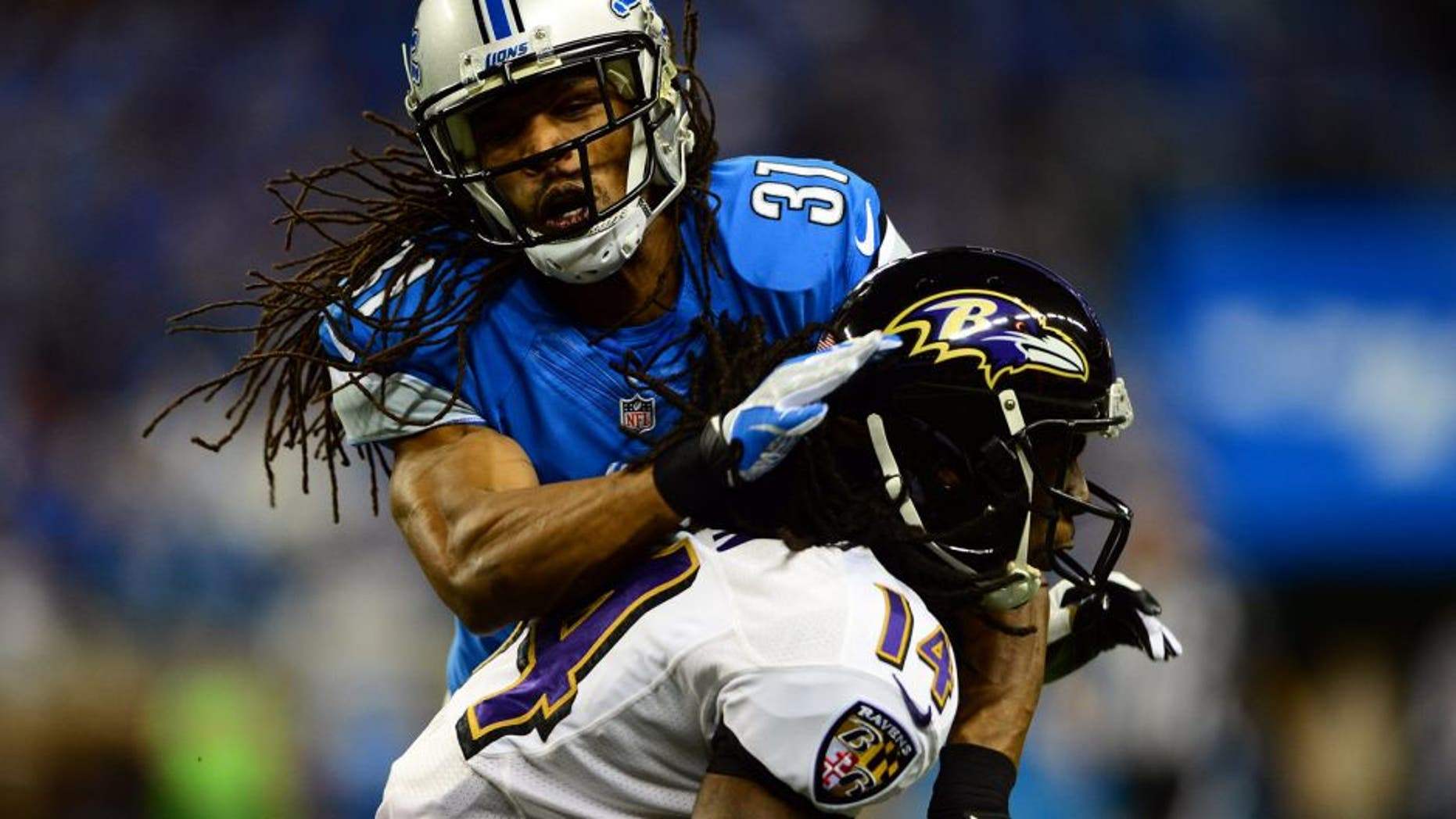 Dec 16, 2013; Detroit, MI, USA; Detroit Lions cornerback Rashean Mathis (31) tackles by Baltimore Ravens wide receiver Marlon Brown (14) during the second quarter at Ford Field. Mandatory Credit: Andrew Weber-USA TODAY Sports