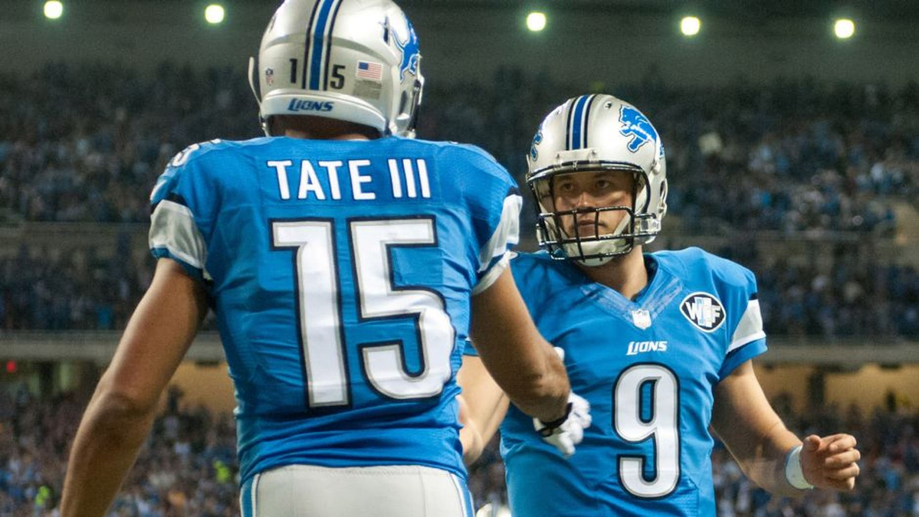 Dec 14, 2014; Detroit, MI, USA; Detroit Lions wide receiver Golden Tate (15) celebrates his touchdown with quarterback Matthew Stafford (9) during the second quarter against the Minnesota Vikings at Ford Field. Mandatory Credit: Tim Fuller-USA TODAY Sports