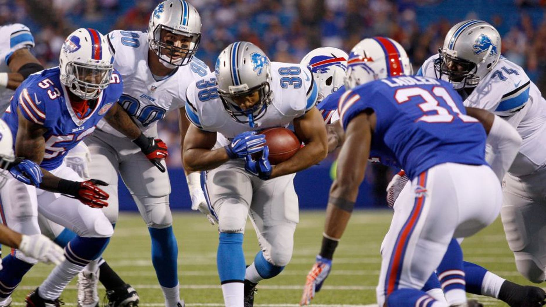 Aug 28, 2014; Orchard Park, NY, USA; Detroit Lions running back George Winn (38) runs the ball during the first half against the Buffalo Bills at Ralph Wilson Stadium. Mandatory Credit: Timothy T. Ludwig-USA TODAY Sports