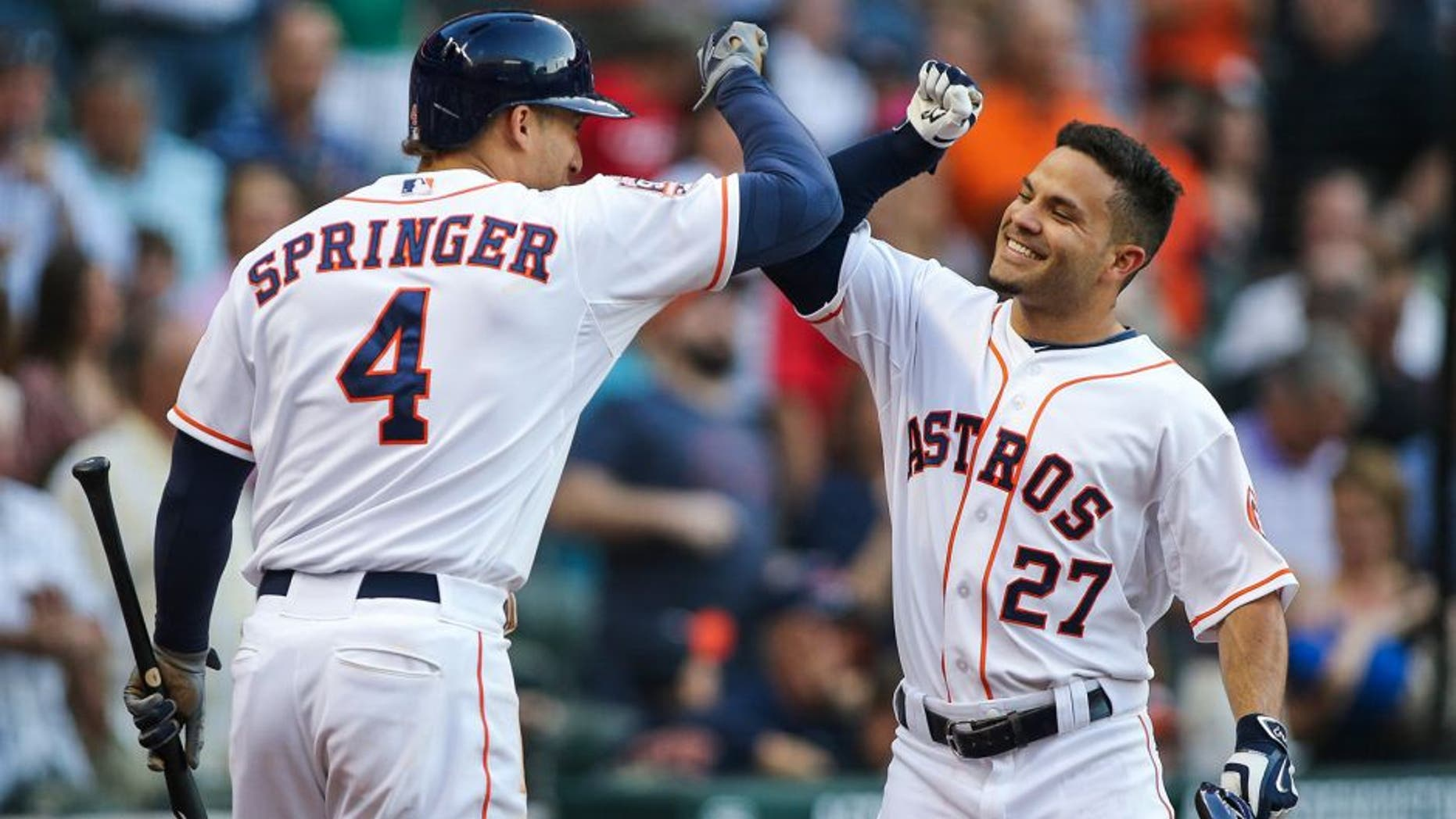 May 2, 2015; Houston, TX, USA; Houston Astros second baseman Jose Altuve (27) celebrates with right fielder George Springer (4) after hitting a home run during the fourth inning against the Seattle Mariners at Minute Maid Park. Mandatory Credit: Troy Taormina-USA TODAY Sports