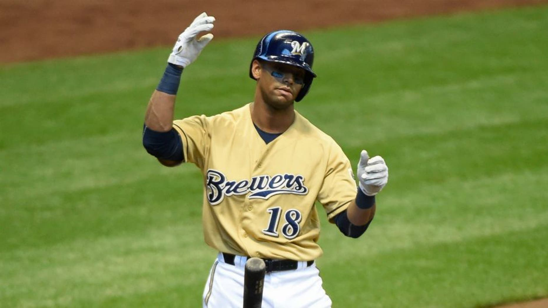 Apr 26, 2015; Milwaukee, WI, USA; Milwaukee Brewers left fielder Khris Davis (18) reacts after striking out in the first inning during the game against the St. Louis Cardinals at Miller Park. Mandatory Credit: Benny Sieu-USA TODAY Sports