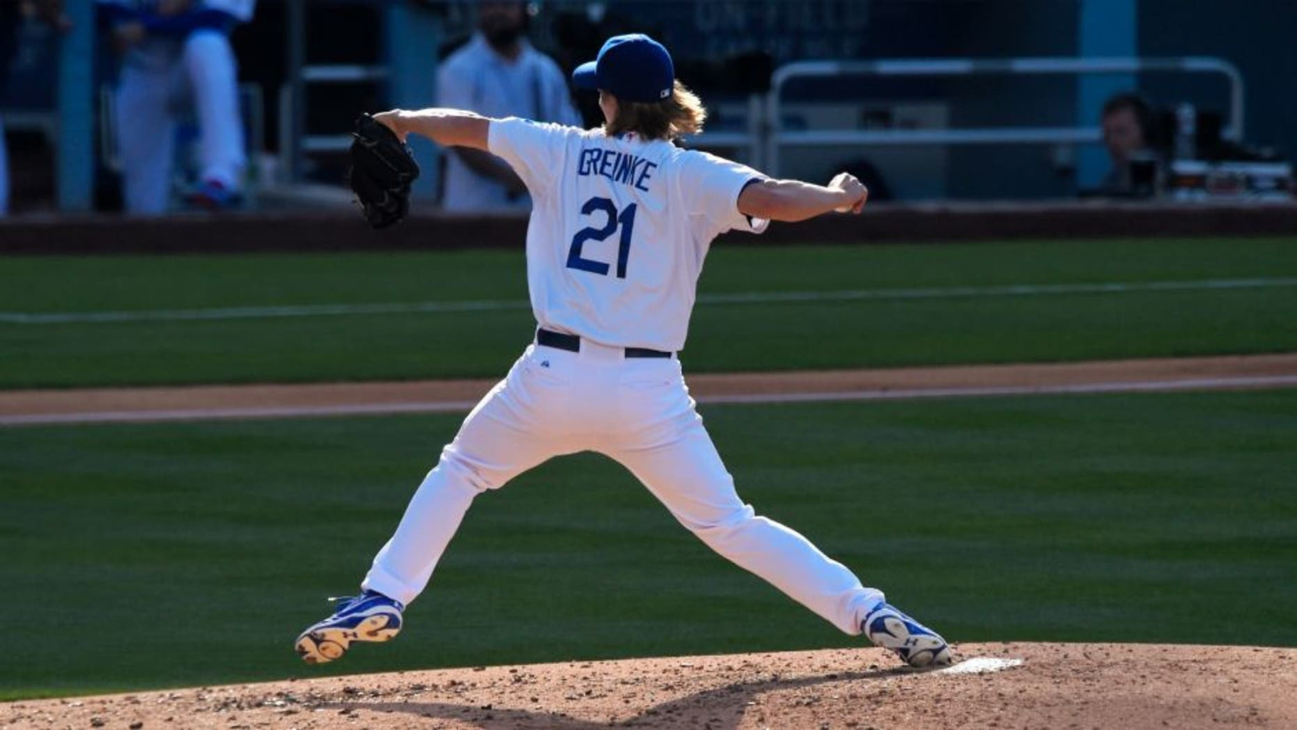 Los Angeles Dodgers starting pitcher Zack Greinke throws to the plate during the third inning of a baseball game against the St. Louis Cardinals, Sunday, June 7, 2015, in Los Angeles. (AP Photo/Mark J. Terrill)