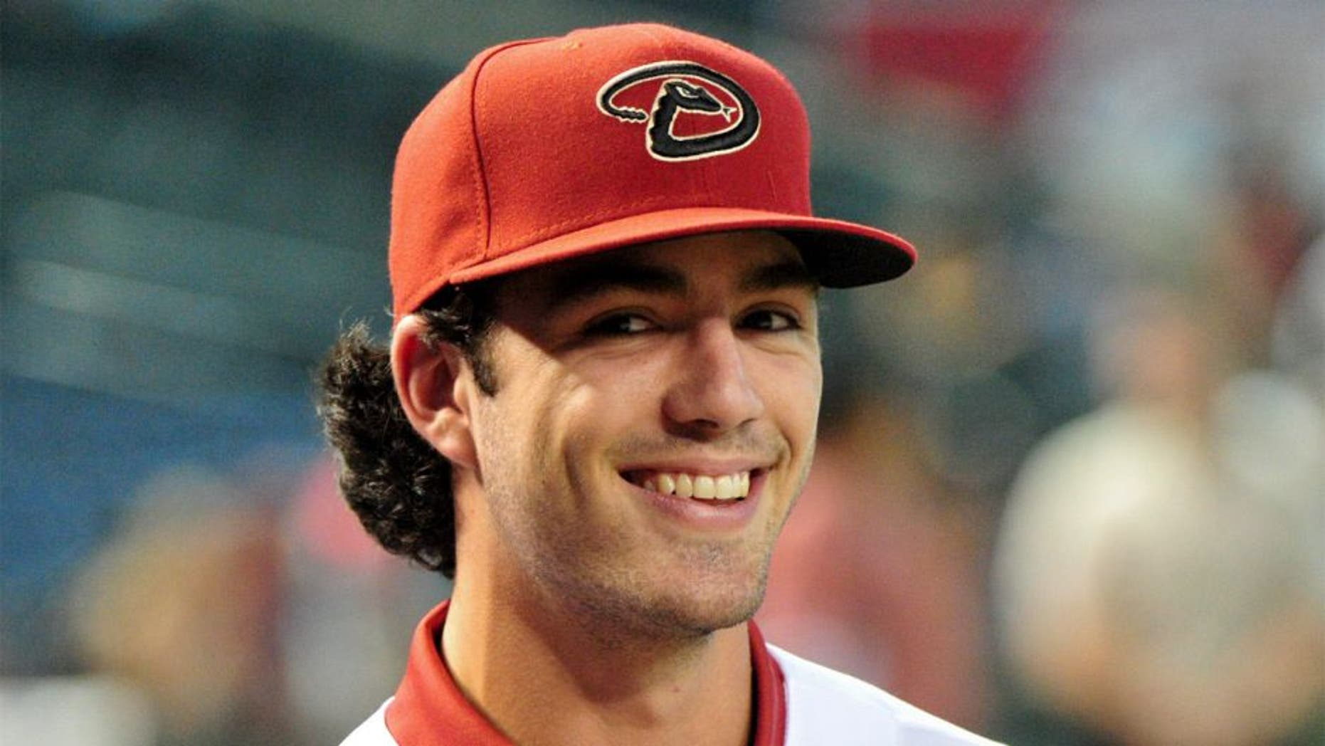 Jul 20, 2015; Phoenix, AZ, USA; First overall pick in the 2015 MLB draft Dansby Swanson looks on after signing with the Arizona Diamondbacks at Chase Field. Mandatory Credit: Matt Kartozian-USA TODAY Sports