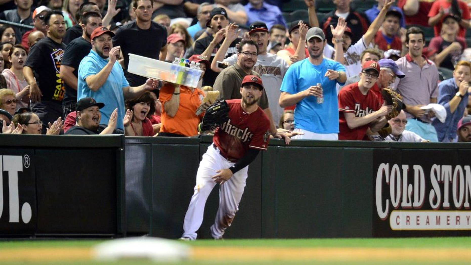 Apr 22, 2015; Phoenix, AZ, USA; Fans react to a sliding catch by Arizona Diamondbacks center fielder Ender Inciarte (5) during the fourth inning against the Texas Rangers at Chase Field. Mandatory Credit: Joe Camporeale-USA TODAY Sports