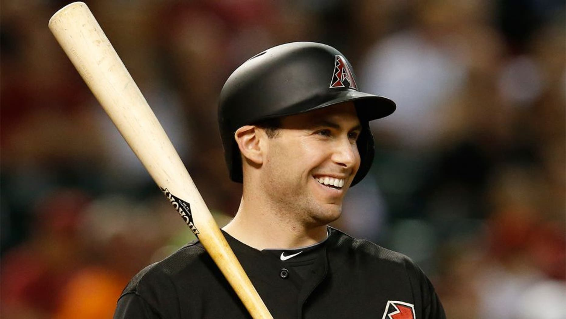 """FILE - In this June 6, 2015, file photo, Arizona Diamondbacks Paul Goldschmidt reacts while being intentionally walked in the eighth inning of a baseball game against the New York Mets in Phoenix. Goldschmidt is having a season as good as anyone in the majors. Yet the attention he receives nationally is far less thant the other so-called big names in the game. His response? """"I couldn't care less."""" (AP Photo/Rick Scuteri, File)"""