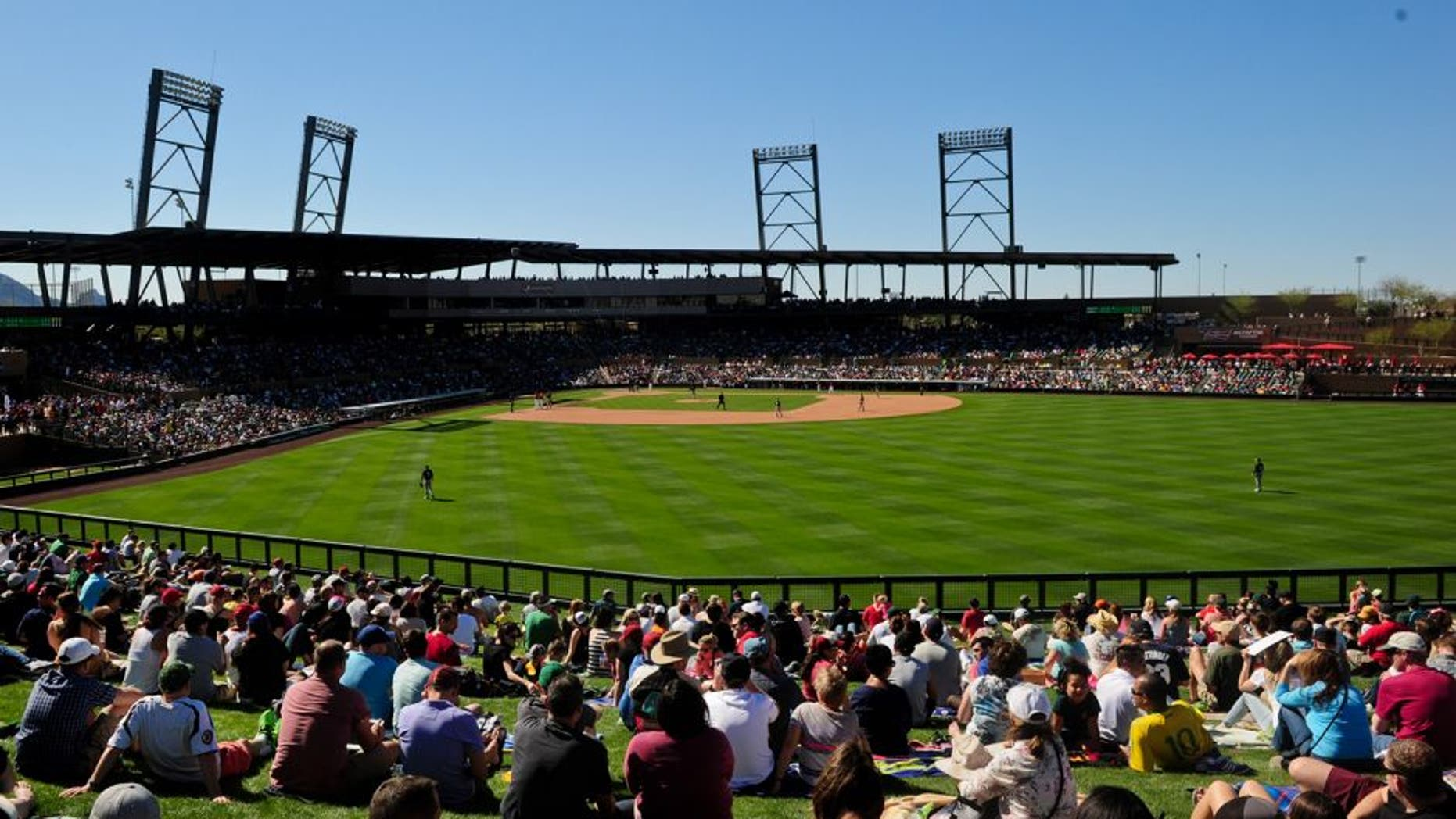 Mar 6, 2015; Salt River Pima-Maricopa, AZ, USA; Fans watch the game between the Arizona Diamondbacks and the Oakland Athletics from the outfield lawn during a spring training baseball game at Salt River Fields at Talking Stick. Mandatory Credit: Matt Kartozian-USA TODAY Sports