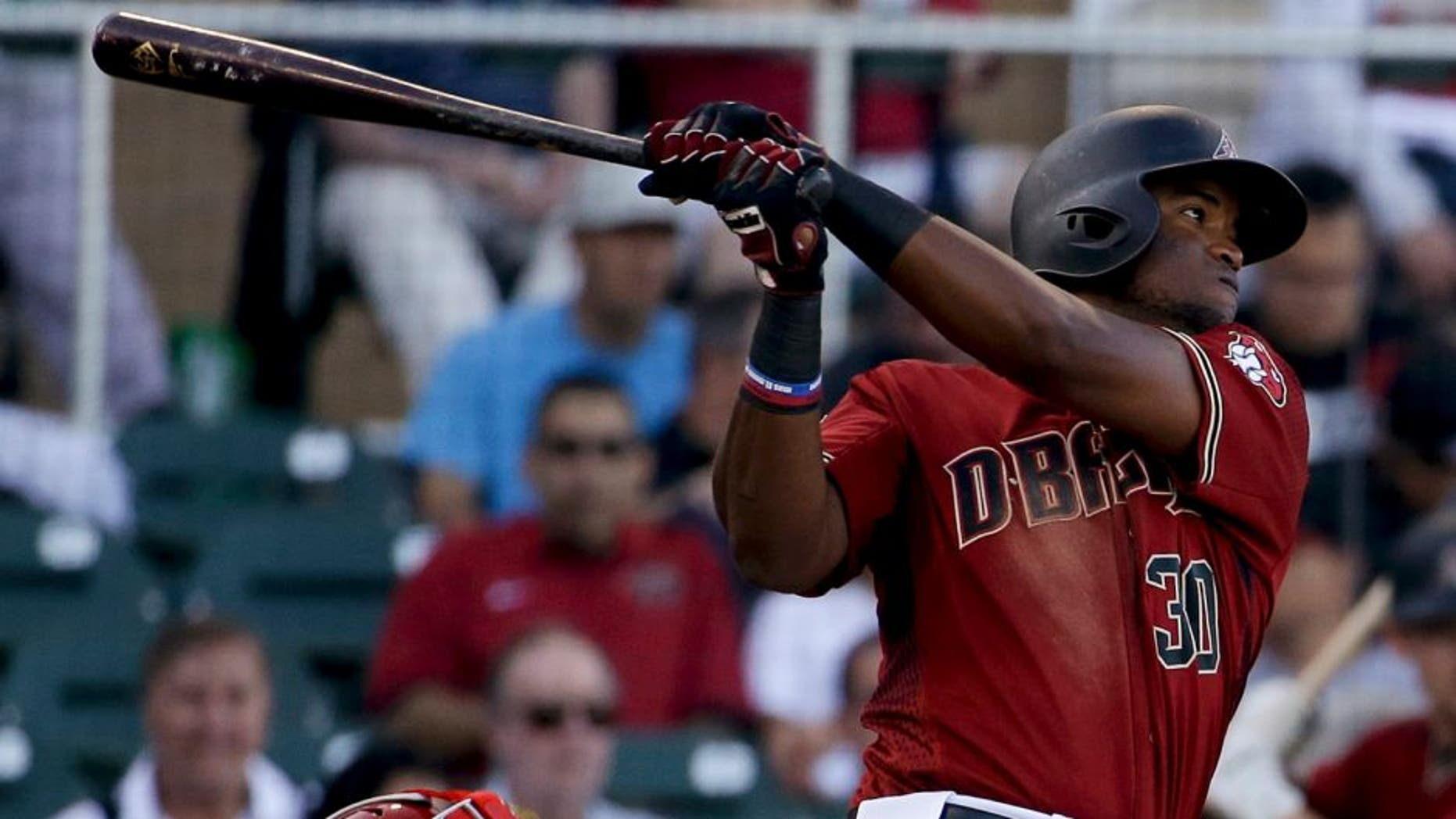 Arizona Diamondbacks' Socrates Brito watches his RBI double against the Los Angeles Angels during third inning of a spring baseball game in Scottsdale, Ariz., Tuesday, March 8, 2016. (AP Photo/Chris Carlson)