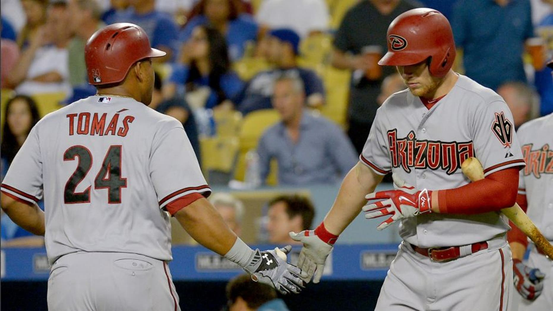 Sep 21, 2015; Los Angeles, CA, USA; Arizona Diamondbacks right fielder Yasmany Tomas (24) is greeted by Arizona Diamondbacks third baseman Brandon Drury (62) after a solo home run in the fourth inning of the game against the Los Angeles Dodgers at Dodger Stadium. Mandatory Credit: Jayne Kamin-Oncea-USA TODAY Sports