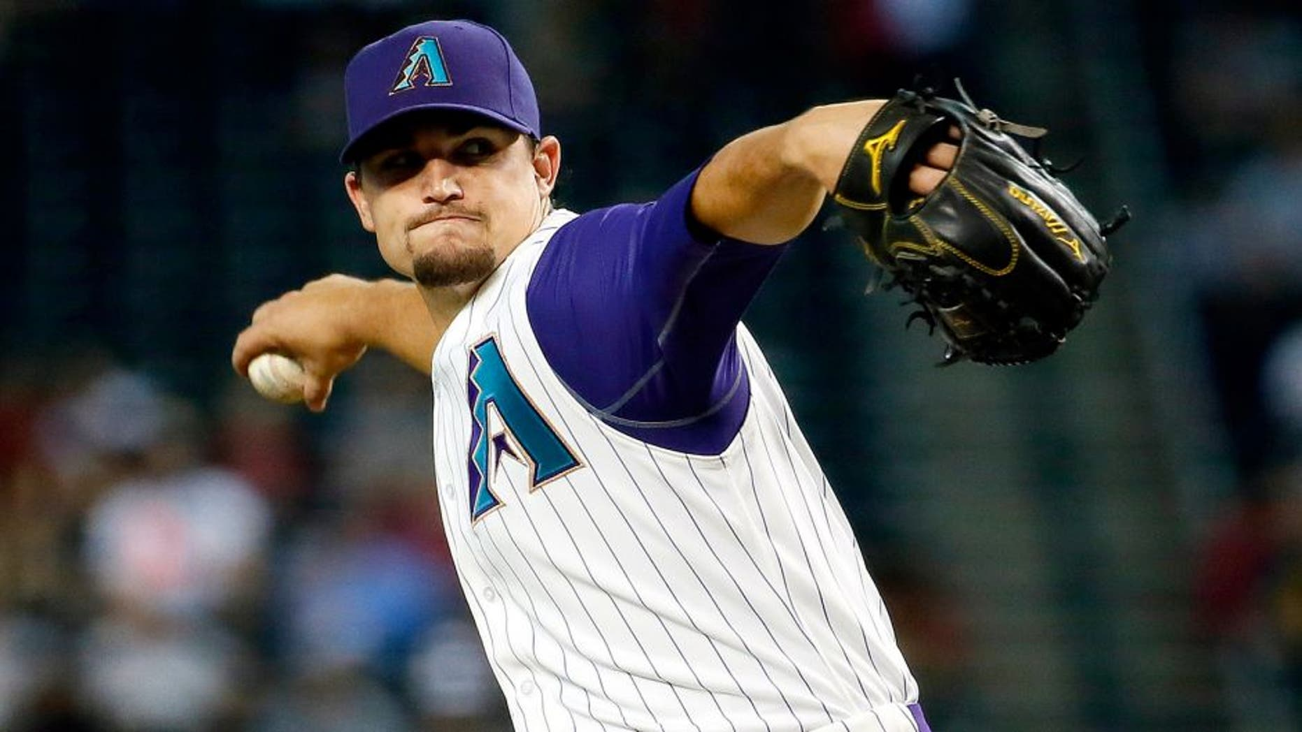 Arizona Diamondbacks pitcher Zack Godley throws during the first inning of a baseball game against the Milwaukee Brewers, Thursday, July 23, 2015, in Phoenix. (AP Photo/Matt York)