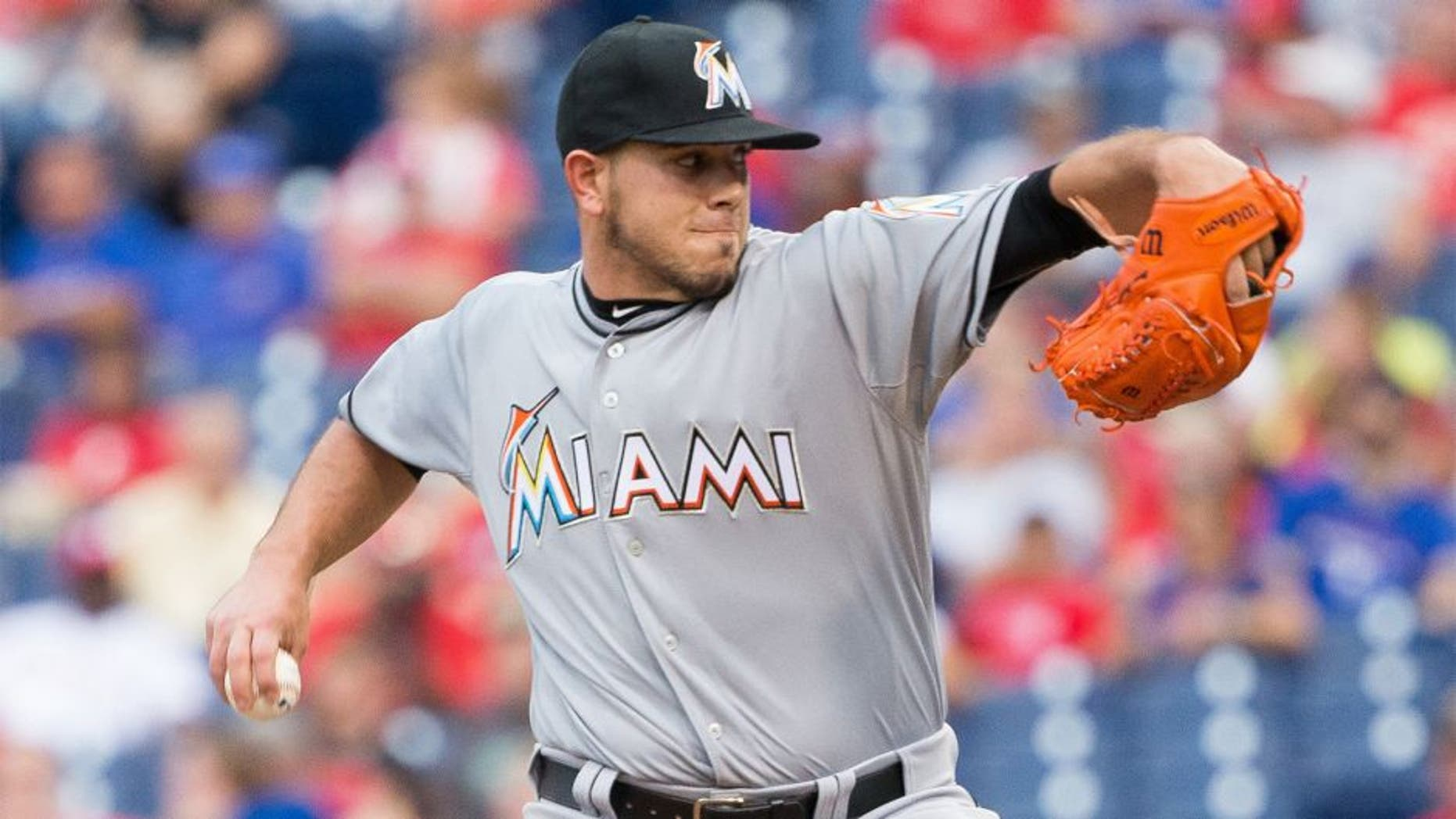 Jul 17, 2015; Philadelphia, PA, USA; Miami Marlins starting pitcher Jose Fernandez (16) pitches against the Philadelphia Phillies during the first inning at Citizens Bank Park. Mandatory Credit: Bill Streicher-USA TODAY Sports