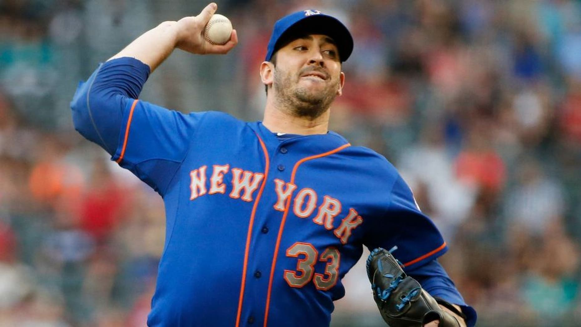 New York Mets' Matt Harvey throws a pitch against the Arizona Diamondbacks during the first inning of a baseball game Thursday, June 4, 2015, in Phoenix. (AP Photo/Ross D. Franklin)