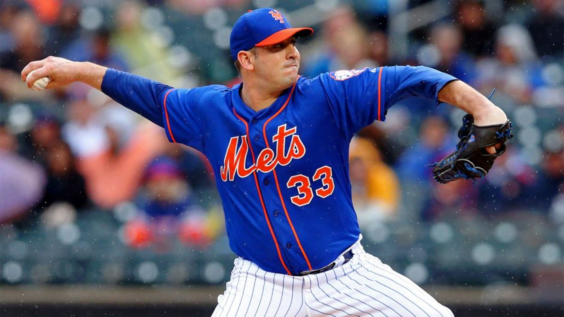 Jun 27, 2015; New York City, NY, USA; New York Mets starting pitcher Matt Harvey (33) pitches against the Cincinnati Reds during the second inning at Citi Field. Mandatory Credit: Brad Penner-USA TODAY Sports