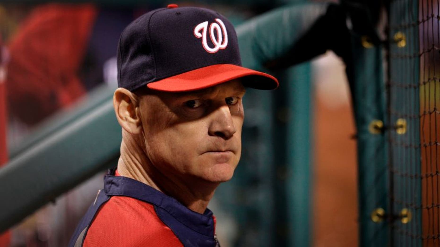 May 11, 2014; Oakland, CA, USA; Washington Nationals manager Matt Williams (9) stands in the dugout against the Oakland Athletics during the sixth inning at O.co Coliseum. The Athletics defeated the Nationals 9-1. Mandatory Credit: Kyle Terada-USA TODAY Sports