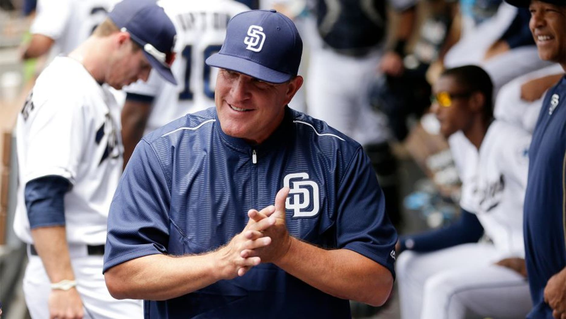 San Diego Padres interim manager Pat Murphy looks on from the dugout before the Padres play the Oakland Athletics in a baseball game Tuesday, June 16, 2015, in San Diego. (AP Photo/Gregory Bull)