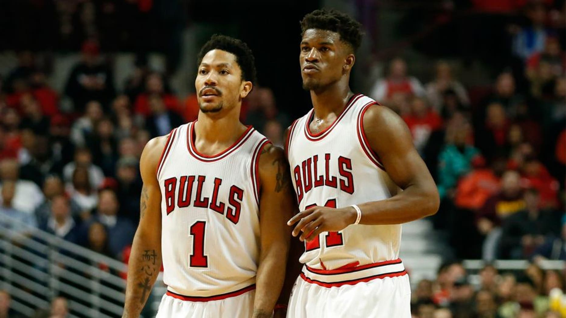 Apr 27, 2015; Chicago, IL, USA; Chicago Bulls guard Derrick Rose (1) and guard Jimmy Butler (21) talk to each other against the Milwaukee Bucks in game five of the first round of the 2015 NBA Playoffs at United Center. The Bucks won 94-88. Mandatory Credit: Kamil Krzaczynski-USA TODAY Sports