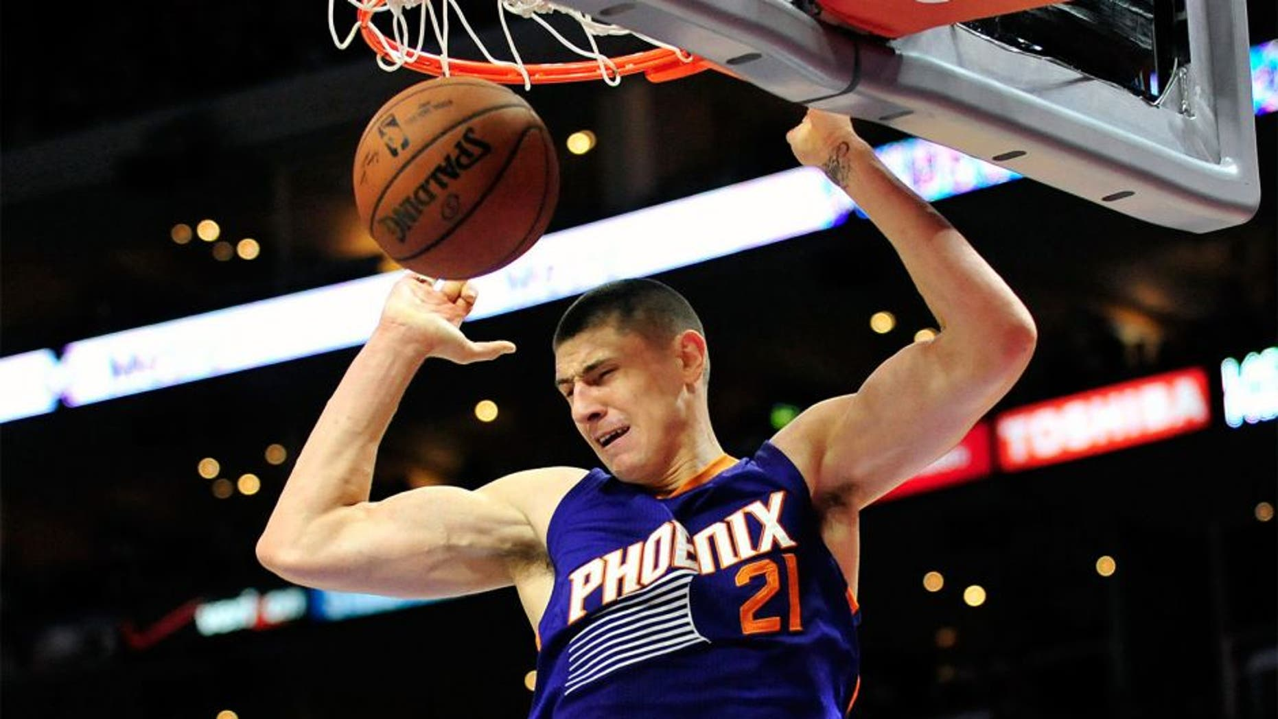 November 15, 2014; Los Angeles, CA, USA; Phoenix Suns center Alex Len (21) dunks to score a basket against the Los Angeles Clippers during the first half at Staples Center. Mandatory Credit: Gary A. Vasquez-USA TODAY Sports