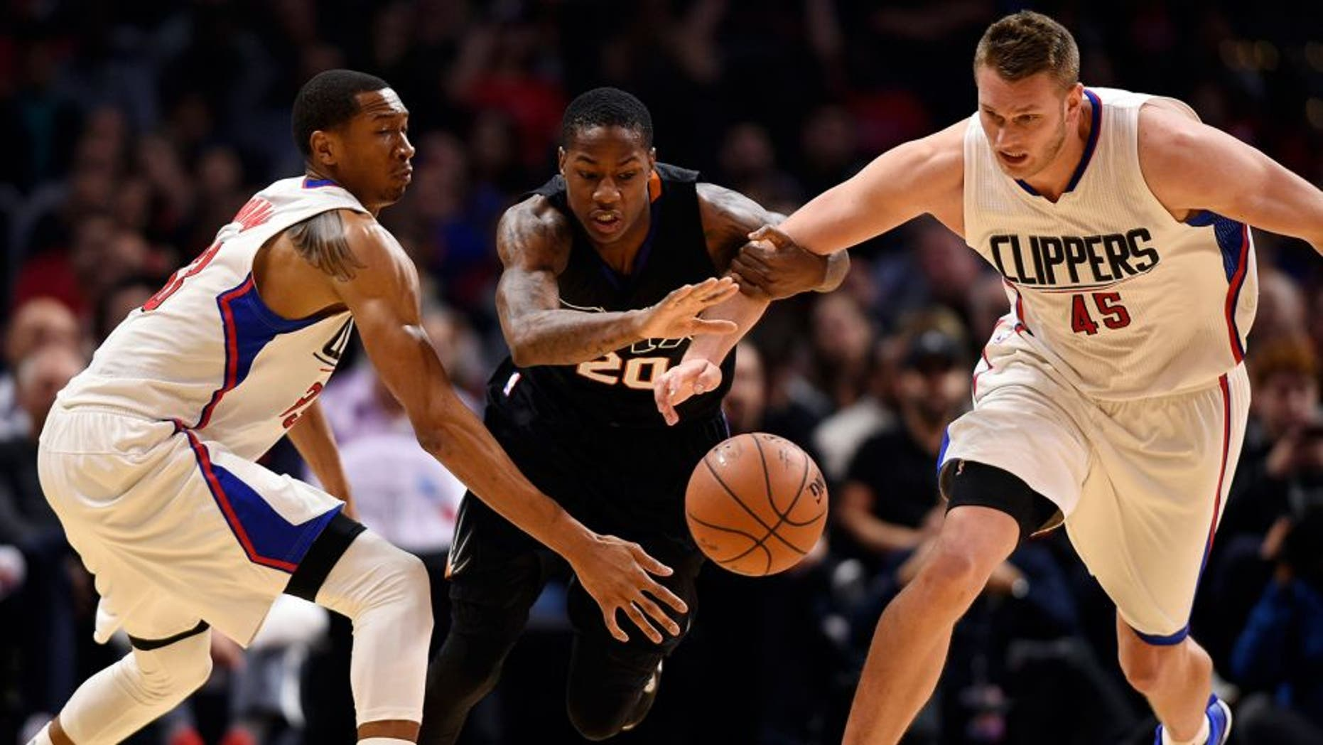 Feb 22, 2016; Los Angeles, CA, USA; Phoenix Suns guard Archie Goodwin (center) battles with Los Angeles Clippers forward Wesley Jonson (left) and center Cole Aldrich (right) for the loose ball during the fourth quarter at Staples Center. The Los Angeles Clippers won 124-84. Mandatory Credit: Kelvin Kuo-USA TODAY Sports