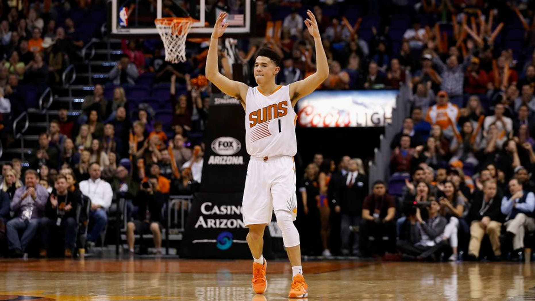PHOENIX, AZ - JANUARY 06: Devin Booker #1 of the Phoenix Suns reacts after the Suns scored against the Charlotte Hornets during the second half of the NBA game at Talking Stick Resort Arena on January 6, 2016 in Phoenix, Arizona. The Suns defeated the Hornets 111-102. NOTE TO USER: User expressly acknowledges and agrees that, by downloading and or using this photograph, User is consenting to the terms and conditions of the Getty Images License Agreement. (Photo by Christian Petersen/Getty Images)