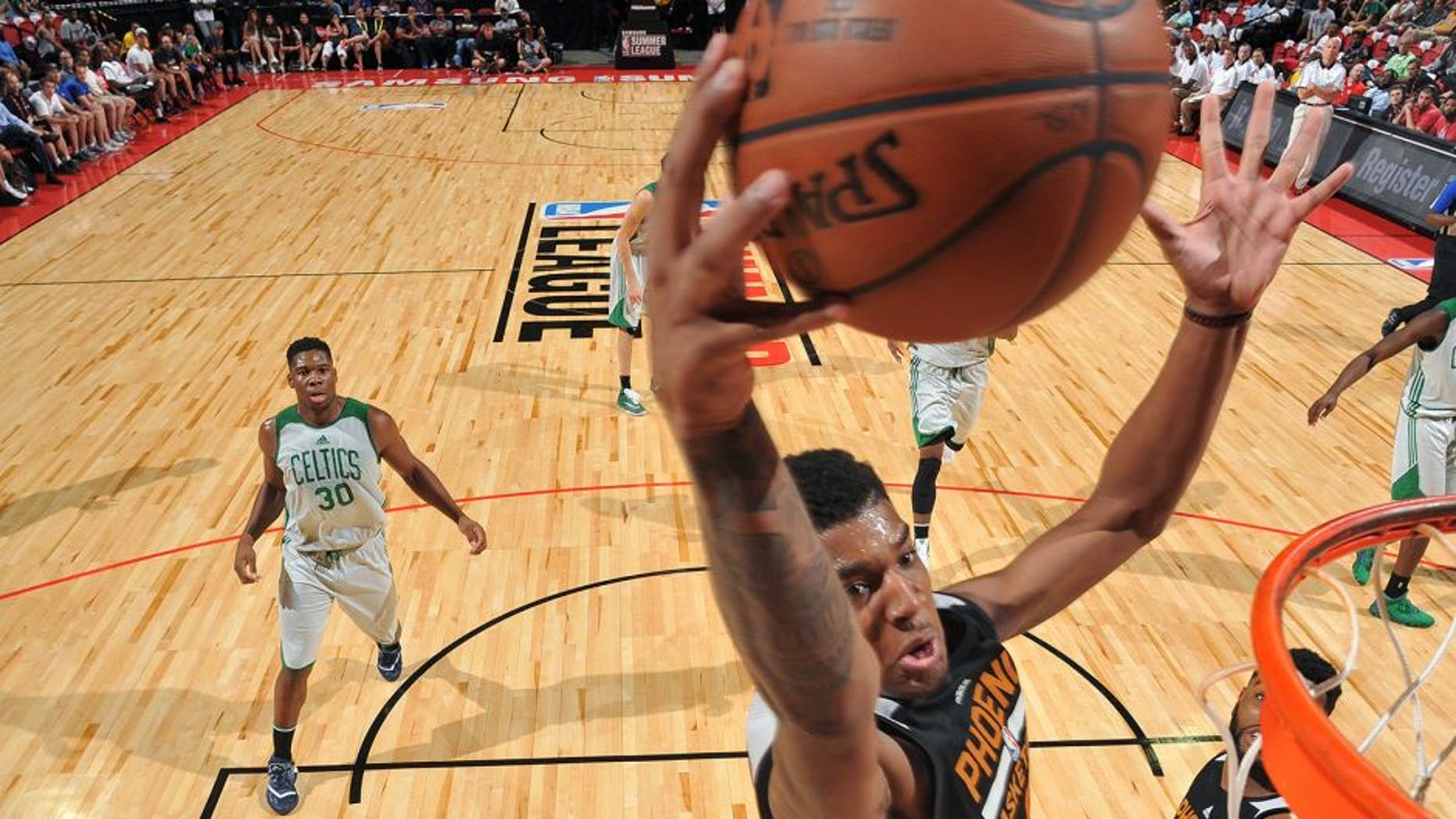 LAS VEGAS, NV - JULY 10: Marquese Chriss #0 of Phoenix Suns goes for the dunk during the game against the Boston Celtics during the 2016 NBA Las Vegas Summer League on July 10, 2016 at the Thomas & Mack Center in Las Vegas, Nevada. NOTE TO USER: User expressly acknowledges and agrees that, by downloading and or using this photograph, user is consenting to the terms and conditions of Getty Images License Agreement. Mandatory Copyright Notice: Copyright 2016 NBAE (Photo by Garrett Ellwood/NBAE via Getty Images)