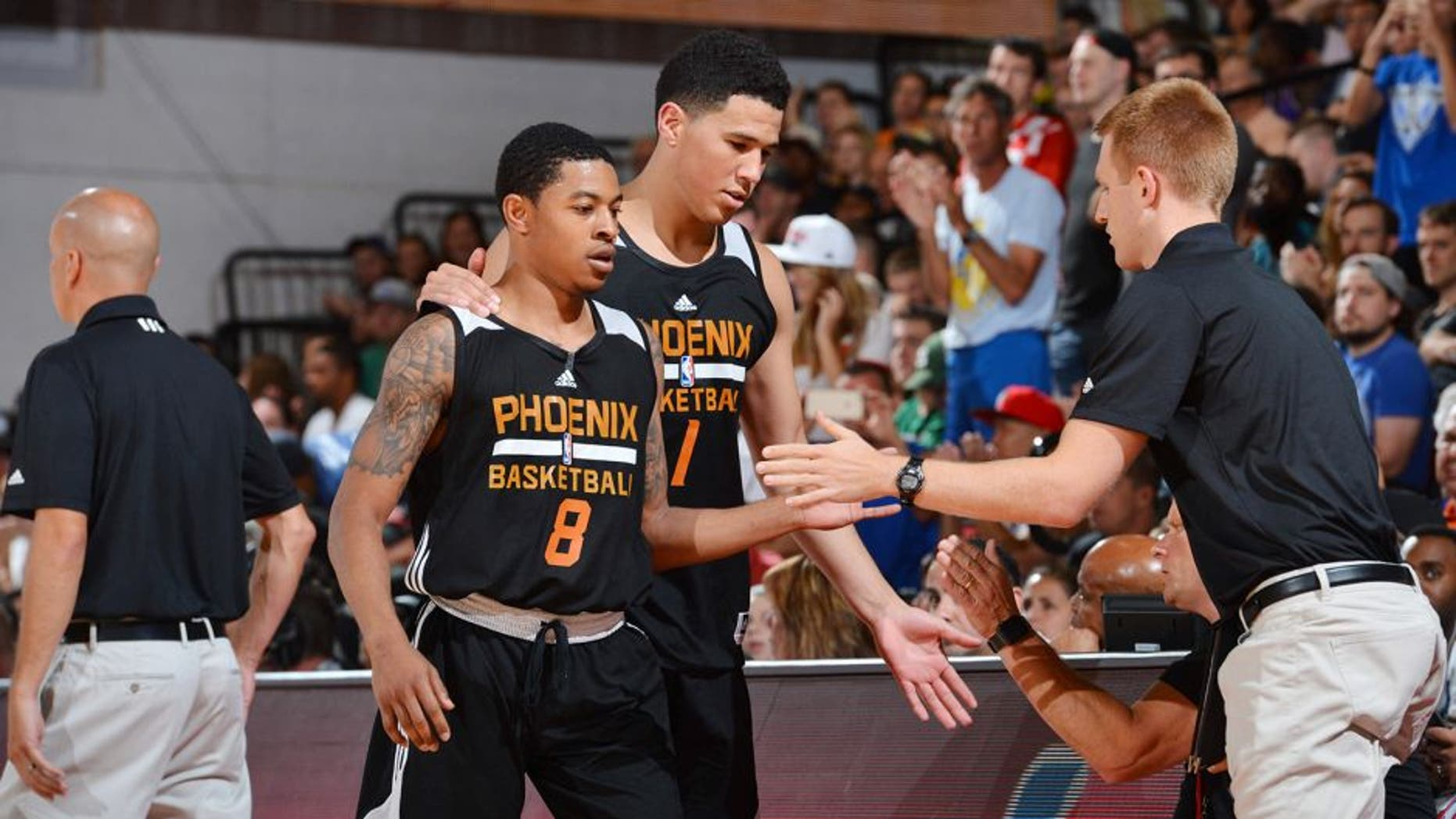 LAS VEGAS, NV - JULY 9: Devin Booker #1 of the Phoenix Suns and Tyler Ulis #8 of the Phoenix Suns shake hands with their teammates during the game against the Portland Trail Blazers during the 2016 NBA Las Vegas Summer League game on July 9, 2016 at the Cox Pavillion in Las Vegas, Nevada. NOTE TO USER: User expressly acknowledges and agrees that, by downloading and or using this photograph, User is consenting to the terms and conditions of the Getty Images License Agreement. Mandatory Copyright Notice: Copyright 2016 NBAE (Photo by David Dow/NBAE via Getty Images)