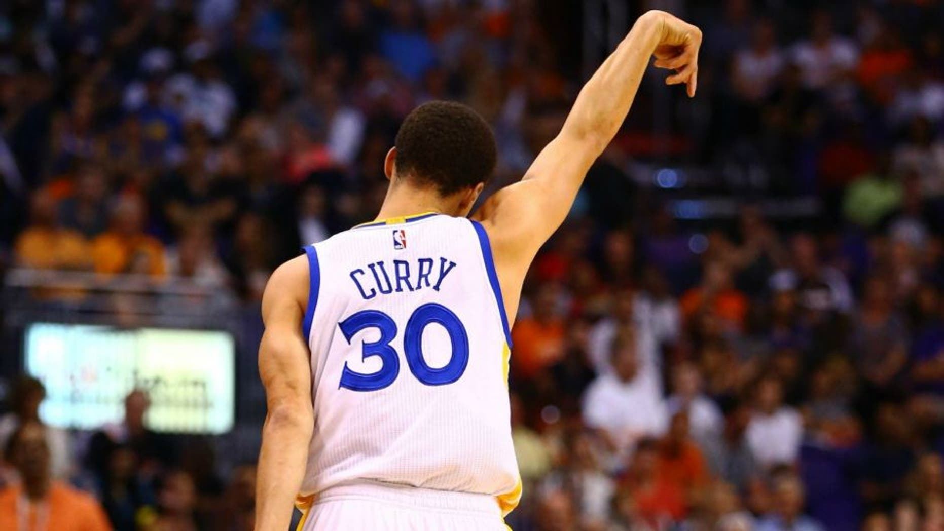 Mar 9, 2015; Phoenix, AZ, USA; Golden State Warriors guard Stephen Curry celebrates a three point shot against the Phoenix Suns in the first quarter at US Airways Center. Mandatory Credit: Mark J. Rebilas-USA TODAY Sports