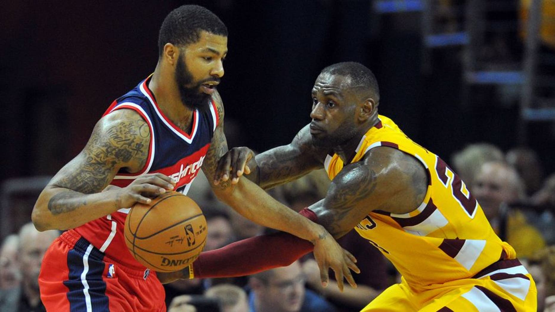 Mar 4, 2016; Cleveland, OH, USA; Cleveland Cavaliers forward LeBron James (23) defends Washington Wizards forward Markieff Morris (5) during the third quarter at Quicken Loans Arena. The Cavs won 108-83. Mandatory Credit: Ken Blaze-USA TODAY Sports