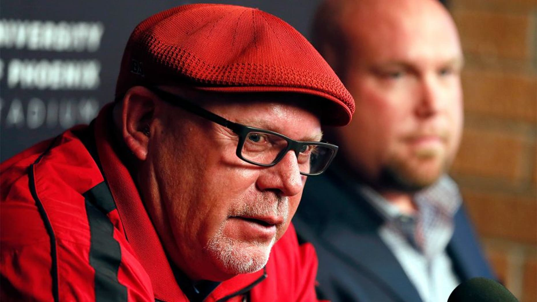 Arizona Cardinals head coach Bruce Arians, left, and general manager Steve Keim speak during a news conference Tuesday, Feb. 24, 2015, in Tempe, Ariz. Both Keim and Arians were given contract extensions after their successful 2014 season. (AP Photo/Matt York)