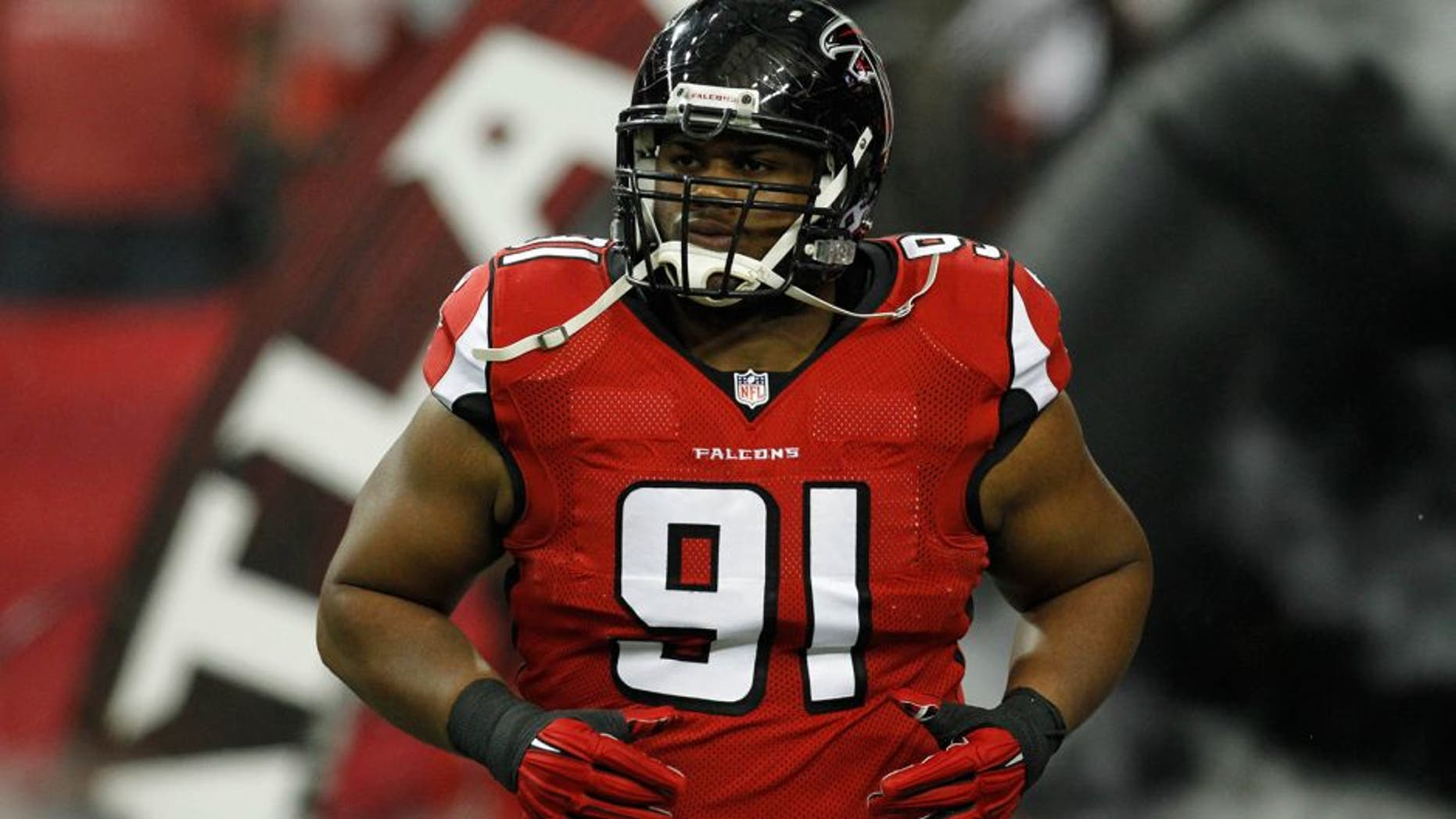 Nov 30, 2014; Atlanta, GA, USA; Atlanta Falcons defensive tackle Corey Peters (91) runs on the field before a game against the Arizona Cardinals at the Georgia Dome. Mandatory Credit: Brett Davis-USA TODAY Sports