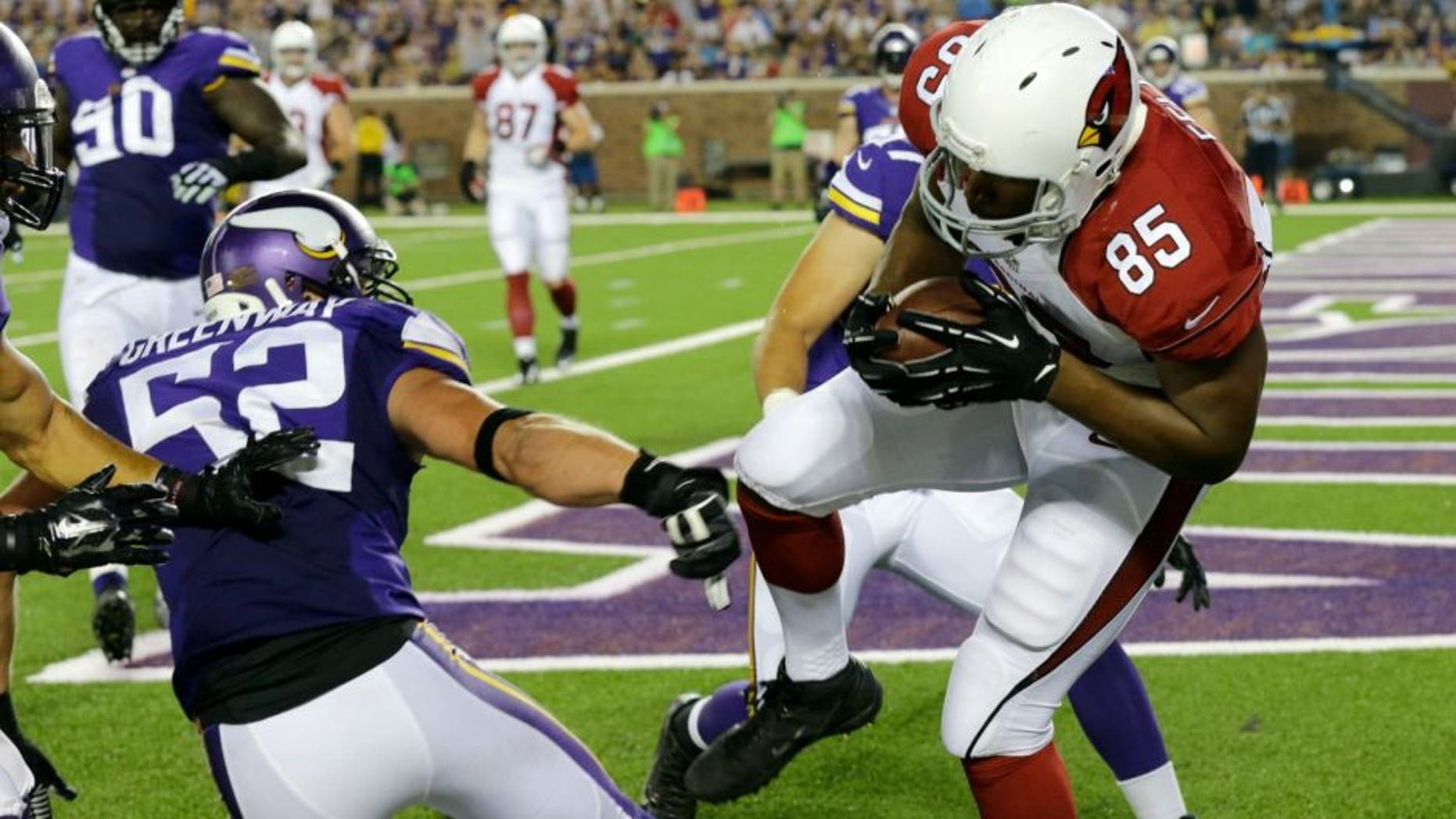 Arizona Cardinals tight end Darren Fells (85) catches a 1-yard touchdown pass in front of Minnesota Vikings outside linebacker Chad Greenway (52) during the first half of an NFL preseason football game, Saturday, Aug. 16, 2014, in Minneapolis. (AP Photo/Ann Heisenfelt)