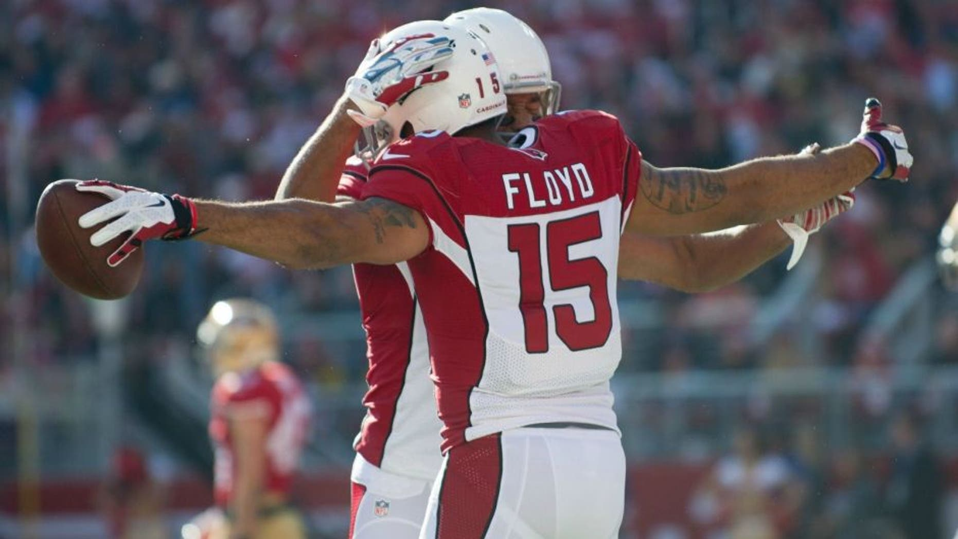 Dec 28, 2014; Santa Clara, CA, USA; Arizona Cardinals wide receiver Michael Floyd (15) celebrates with wide receiver Larry Fitzgerald (11) after scoring a touchdown during the first quarter against the San Francisco 49ers at Levi's Stadium. The against the San Francisco 49ers defeated the Arizona Cardinals 20-17. Mandatory Credit: Ed Szczepanski-USA TODAY Sports