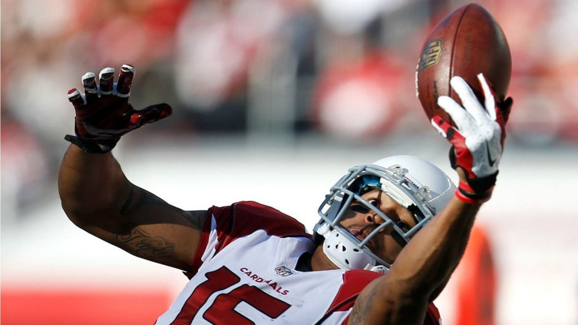Arizona Cardinals wide receiver Michael Floyd (15) catches a pass against the San Francisco 49ers during the first half of an NFL football game in Santa Clara, Calif., Sunday, Dec. 28, 2014. (AP Photo/Tony Avelar)
