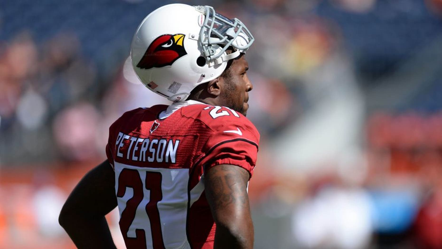 Oct 5, 2014; Denver, CO, USA; Arizona Cardinals cornerback Patrick Peterson (21) before the start of the game against the Denver Broncos at Sports Authority Field at Mile High. Mandatory Credit: Ron Chenoy-USA TODAY Sports