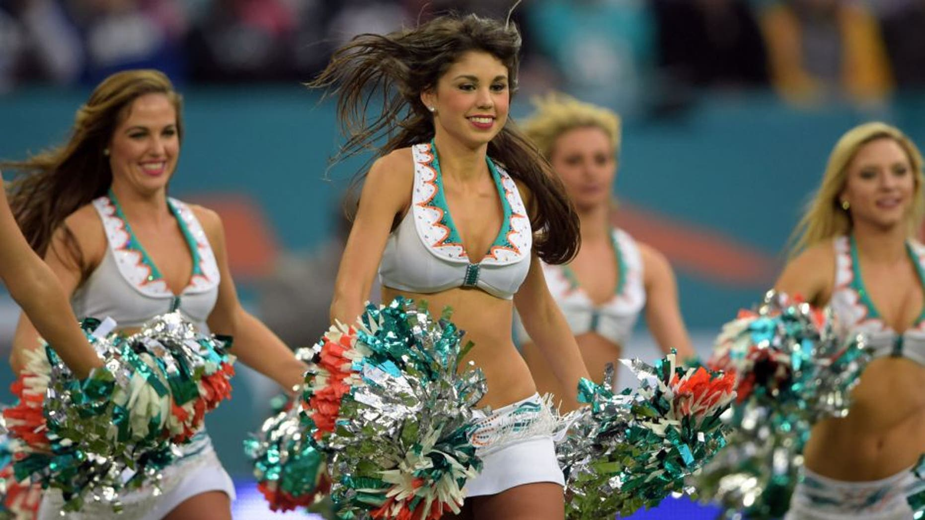 Oct 4, 2015; London, United Kingdom; Miami Dolphins cheerleaders perform during Game 12 of the NFL International Series against the New York Jets at Wembley Stadium. Mandatory Credit: Kirby Lee-USA TODAY Sports