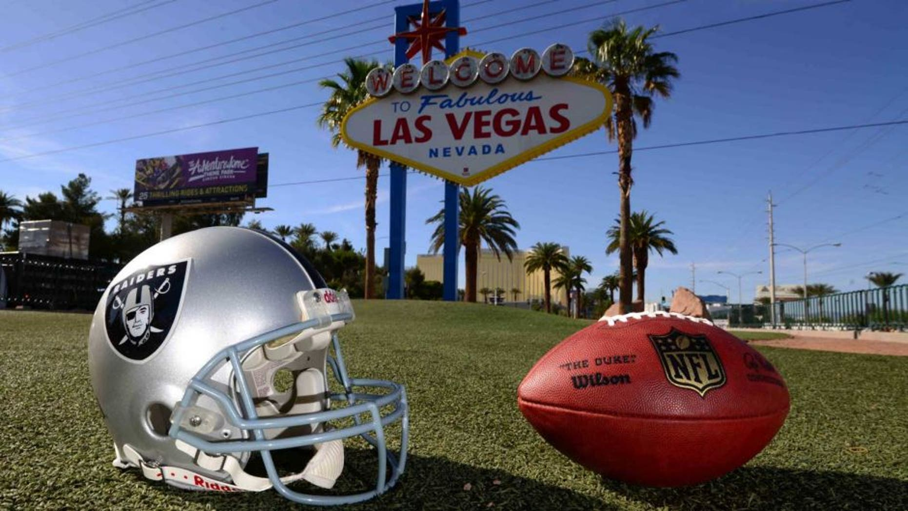 """May 11, 2016; Las Vegas, NV, USA; General view of Oakland Raiders helmet and NFL Wilson Duke football at the """"Welcome to Fabulous Las Vegas"""" sign on the Las Vegas strip on Las Vegas Blvd. Raiders owner Mark Davis (not pictured) has pledged $500 million toward building a 65,000-seat domed stadium in Las Vegas at a total cost of $1.4 billion. NFL commissioner Roger Goodell (not pictured) said Davis can explore his options in Las Vegas but would require 24 of 32 owners to approve the move. Mandatory Credit: Kirby Lee-USA TODAY Sports"""