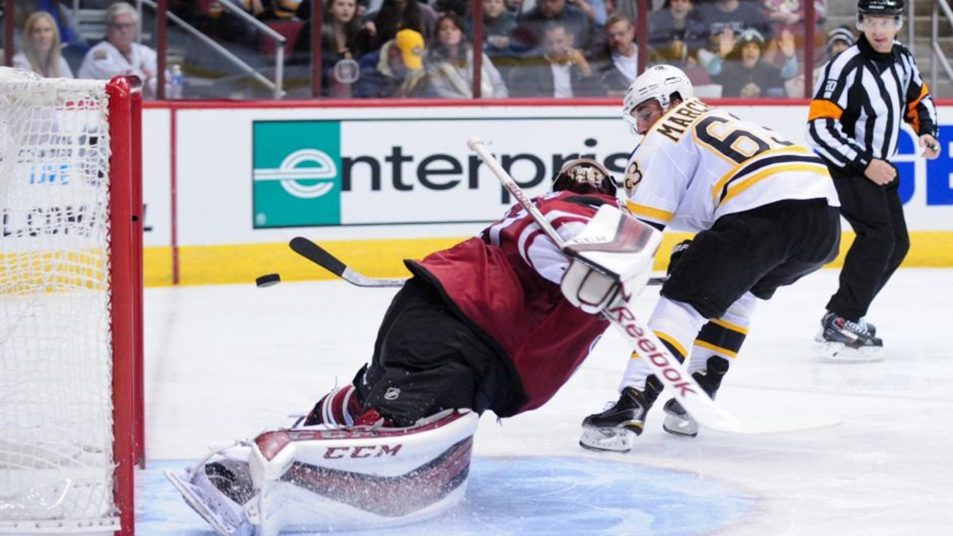 Oct 17, 2015; Glendale, AZ, USA; Boston Bruins left wing Brad Marchand (63) scores on Arizona Coyotes goalie Mike Smith (41) during the third period at Gila River Arena. Mandatory Credit: Matt Kartozian-USA TODAY Sports