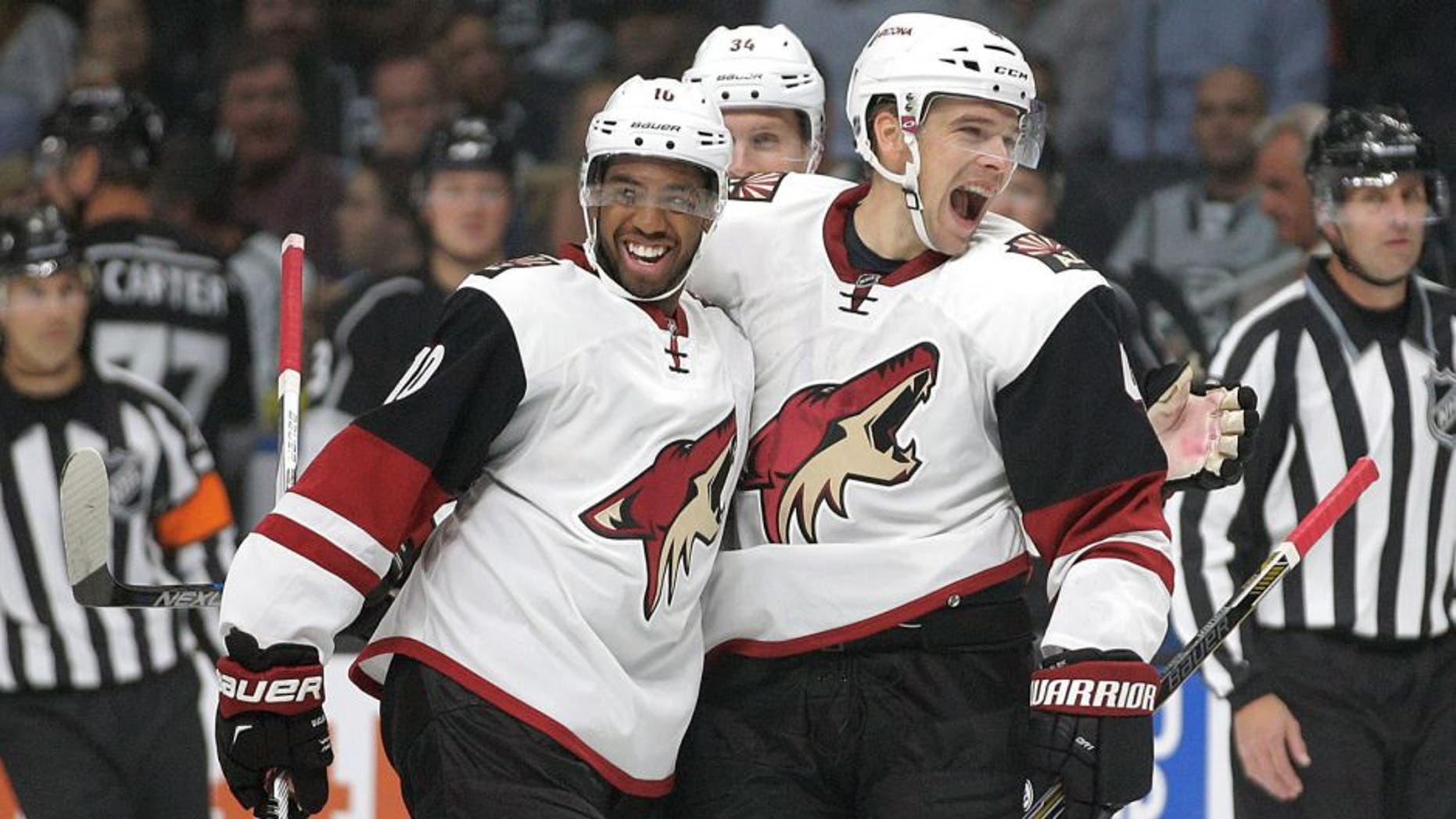 Arizona Coyotes' Zbynek Michalek, right, of the Czech Republic, celebrates his goal with teammate Anthony Duclair during the first period of an NHL hockey game against the Los Angeles Kings, Friday, Oct. 9, 2015, in Los Angeles. (AP Photo/Jae C. Hong)