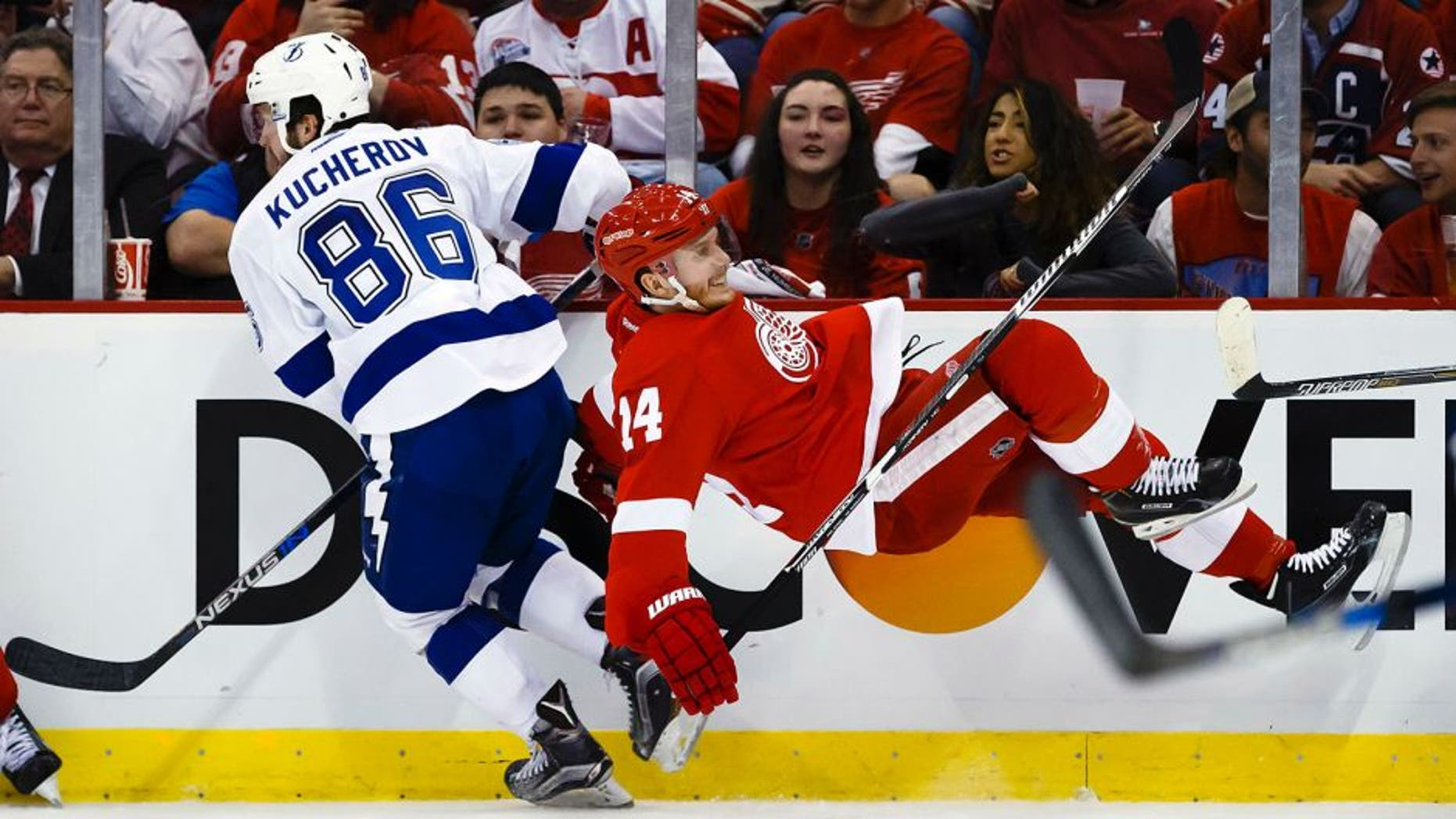 Apr 19, 2016; Detroit, MI, USA; Tampa Bay Lightning right wing Nikita Kucherov (86) checks Detroit Red Wings center Gustav Nyquist (14) during the second period in game four of the first round of the 2016 Stanley Cup Playoffs at Joe Louis Arena. Mandatory Credit: Rick Osentoski-USA TODAY Sports